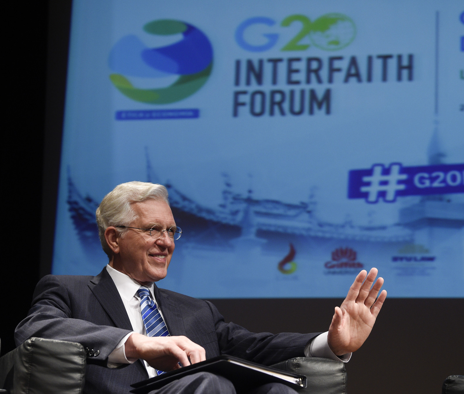 Elder D. Todd Christofferson of the Quorum of the Twelve Apostles greets the audience before his speech at the G20 Interfaith Forum in Buenos Aires, Argentina, on Wednesday, Sept. 26, 2018.