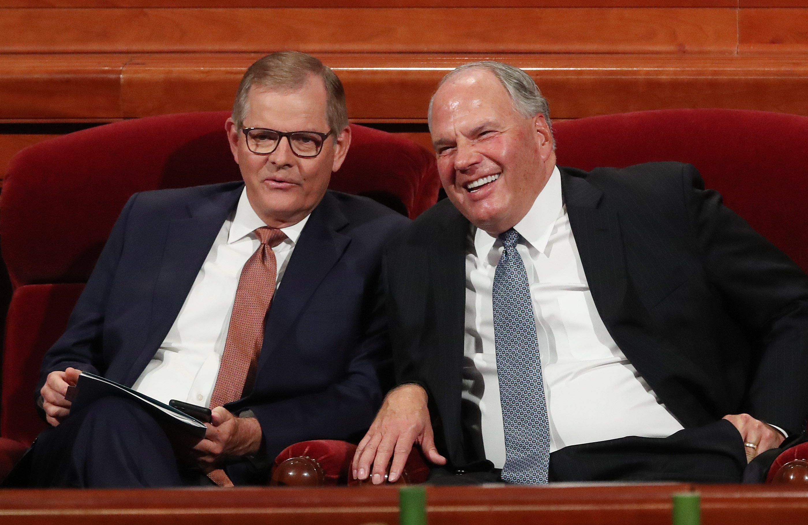 Elder Gary E. Stevenson and Elder Ronald A. Rasband of the Quorum of the Twelve Apostles talk prior to the Sunday afternoon session of the 188th Semiannual General Conference of The Church of Jesus Christ of Latter-day Saints in the Conference Center in Salt Lake City on Sunday, Oct. 7, 2018.