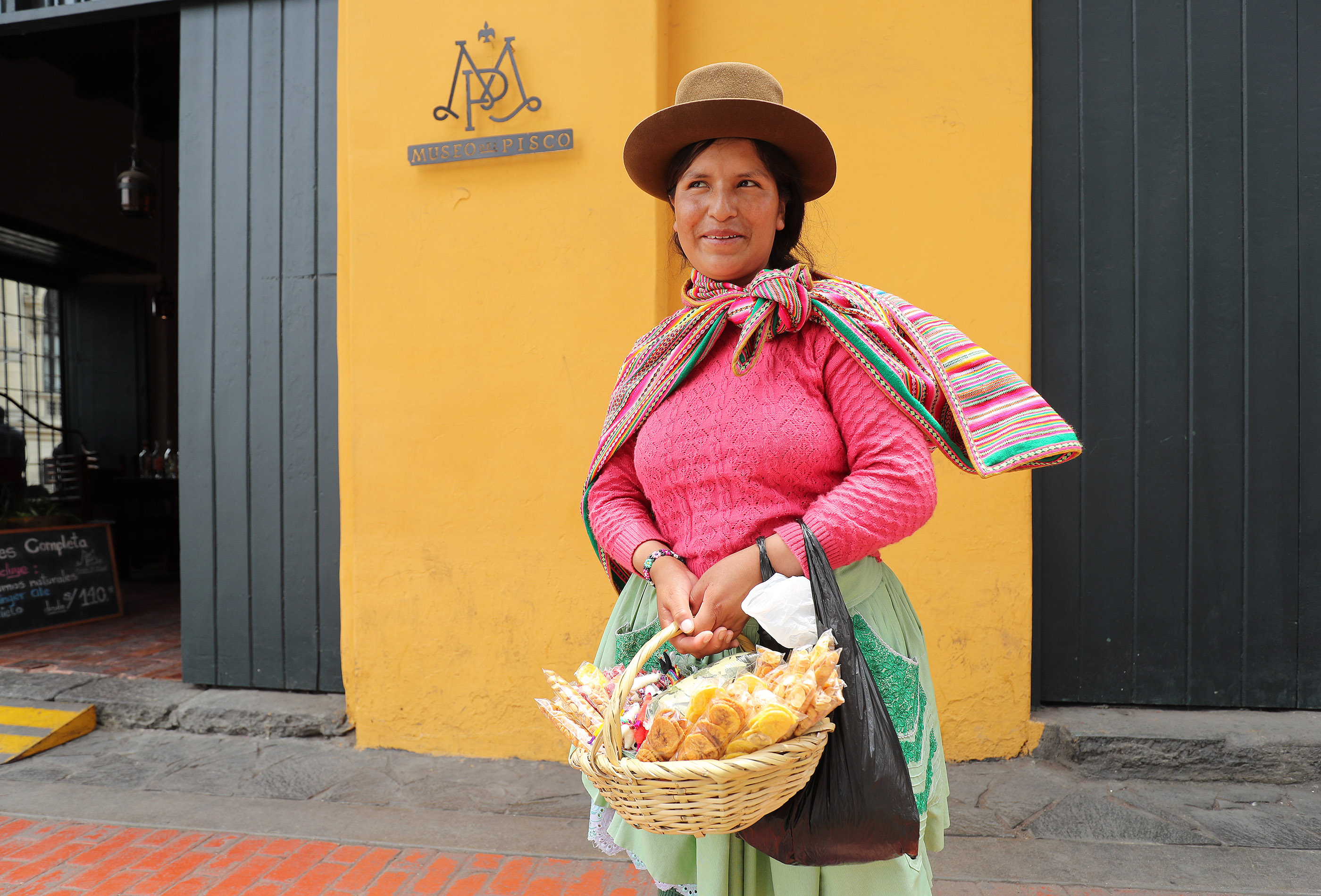 A Peruvian woman sells food and trinkets on the street in Lima, Peru, on Oct. 21, 2018.