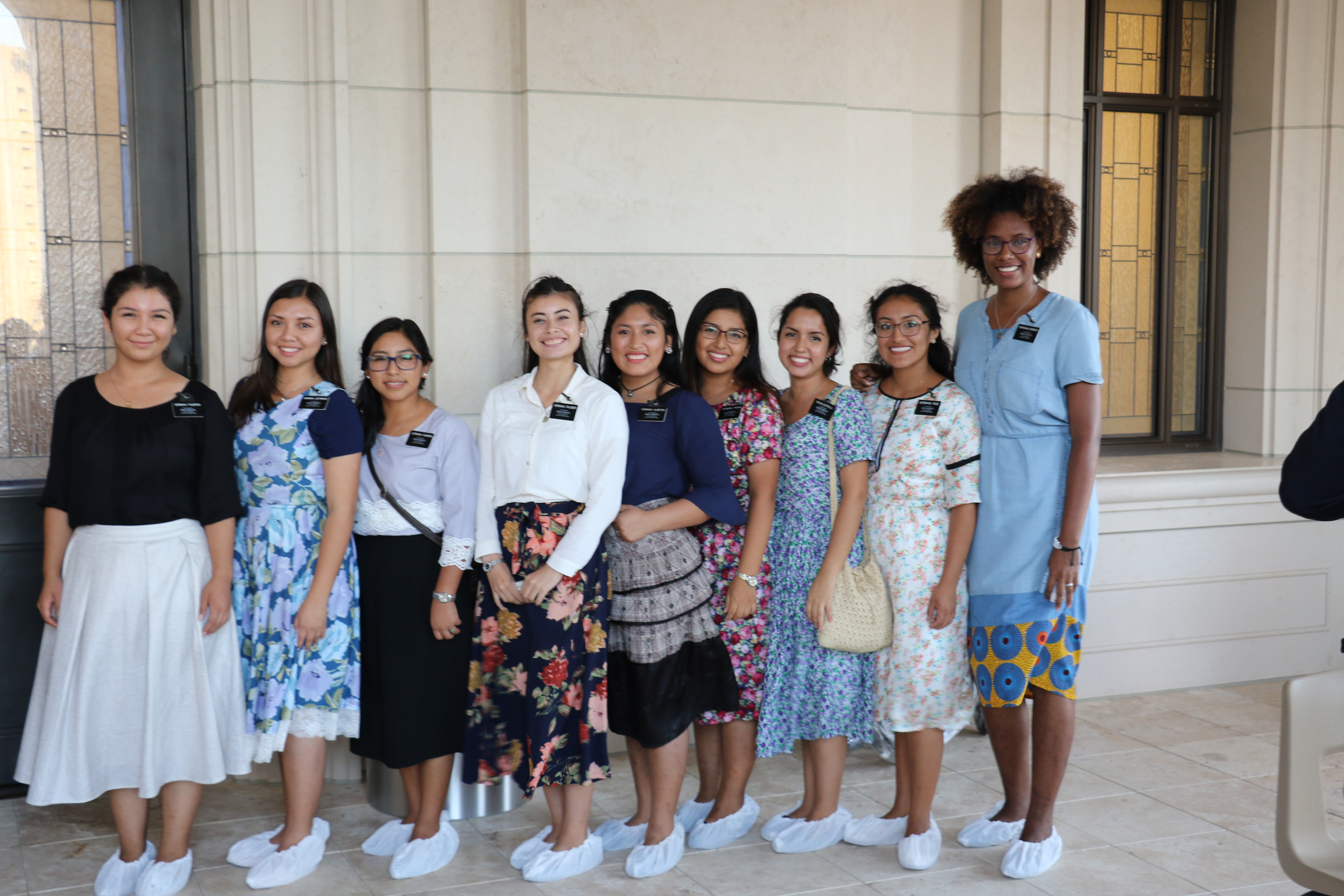 Sister missionaries wait outside the Barranquilla Colombia Temple on Dec. 9, 2018, following the dedication. The sister were helping to clean the temple following the ceremony.