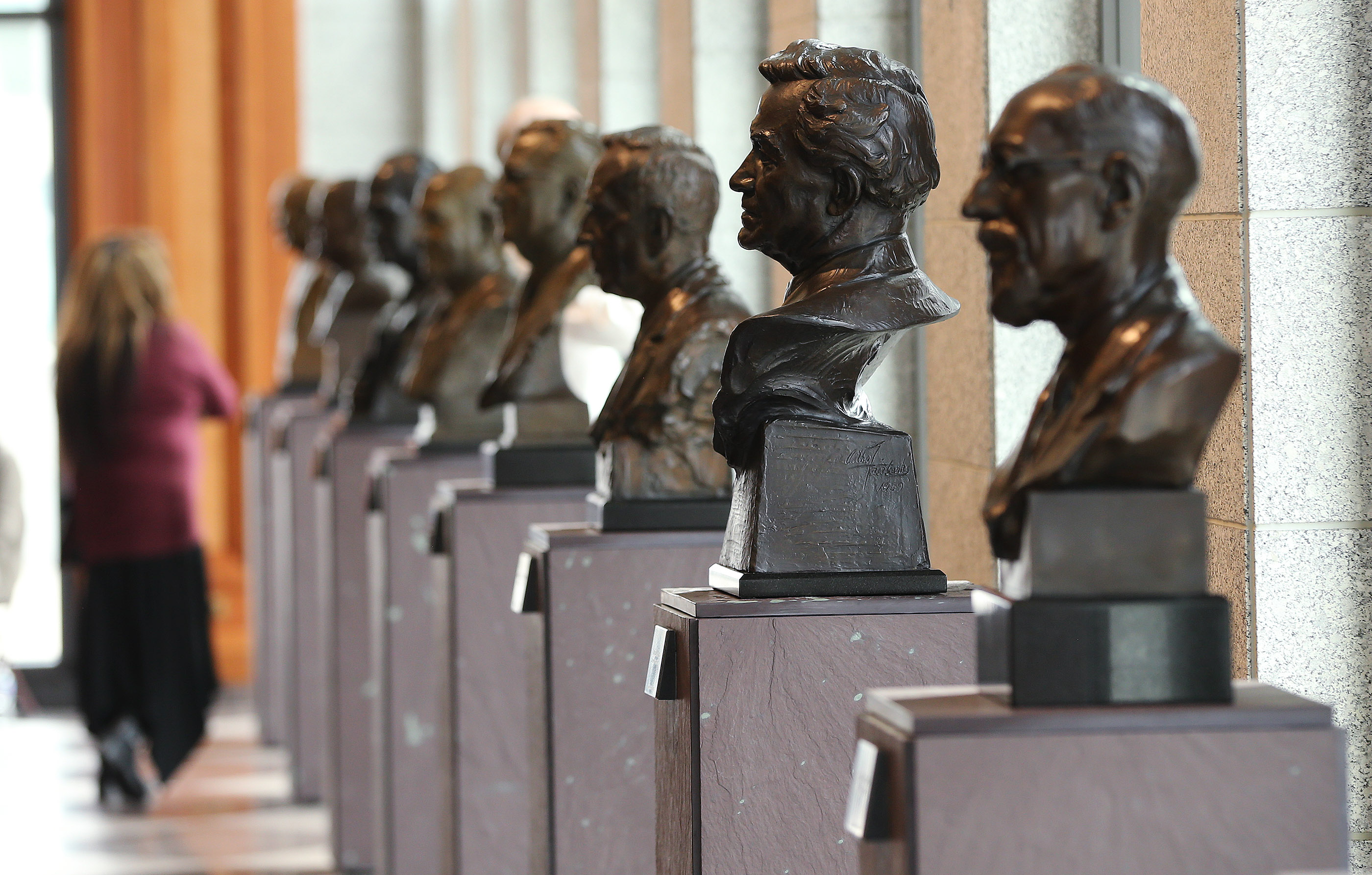A conference attendee looks over busts of church prophets during the 188th Semiannual General Conference of The Church of Jesus Christ of Latter-day Saints in Salt Lake City on Sunday, Oct. 7, 2018.