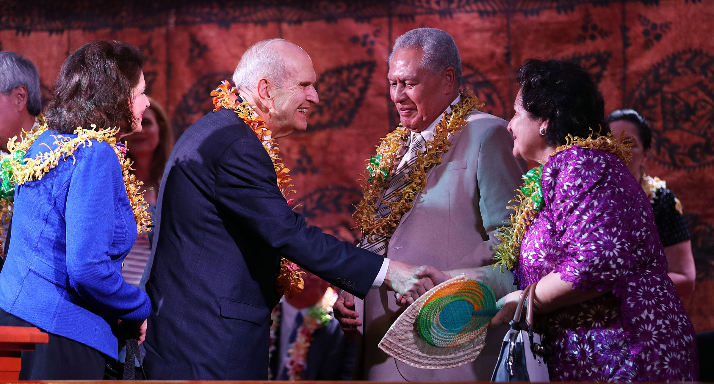 President Russell M. Nelson of The Church of Jesus Christ of Latter-day Saints and his wife, Sister Wendy Nelson, left, greet His Highness Tuimaleali'ifano Va'aleto'a Eti Sualauvi II, Samoa Head of State, and his wife Fa'amausili Leinafo Tuimaleali'ifano, following a devotional in Apia, Samoa on Saturday, May 18, 2019.