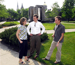 Greg Lambourne, center, and his wife, Jessica, and Bryan Smith are impressed with the education at Notre Dame and upstanding lifestyle.