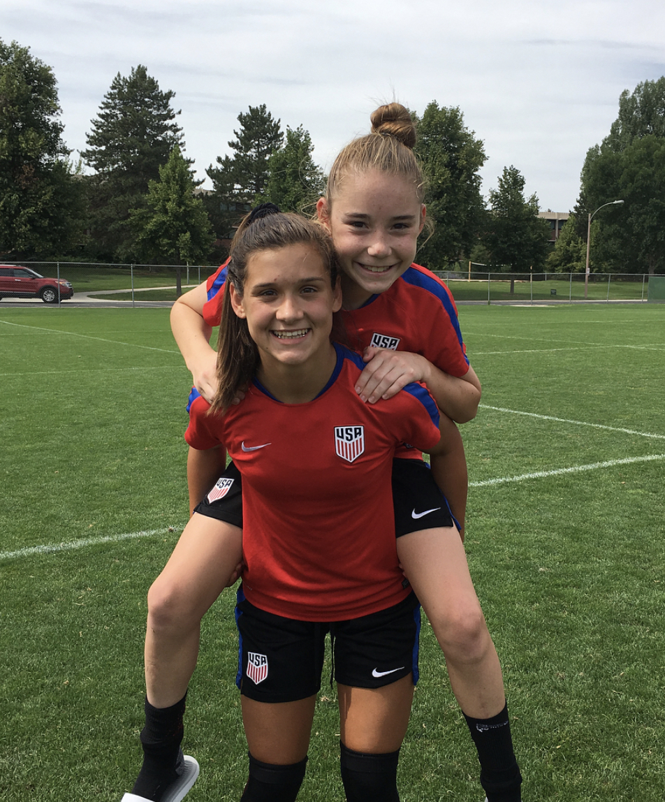 Olivia Moultrie with a friend at a national youth division soccer camp.