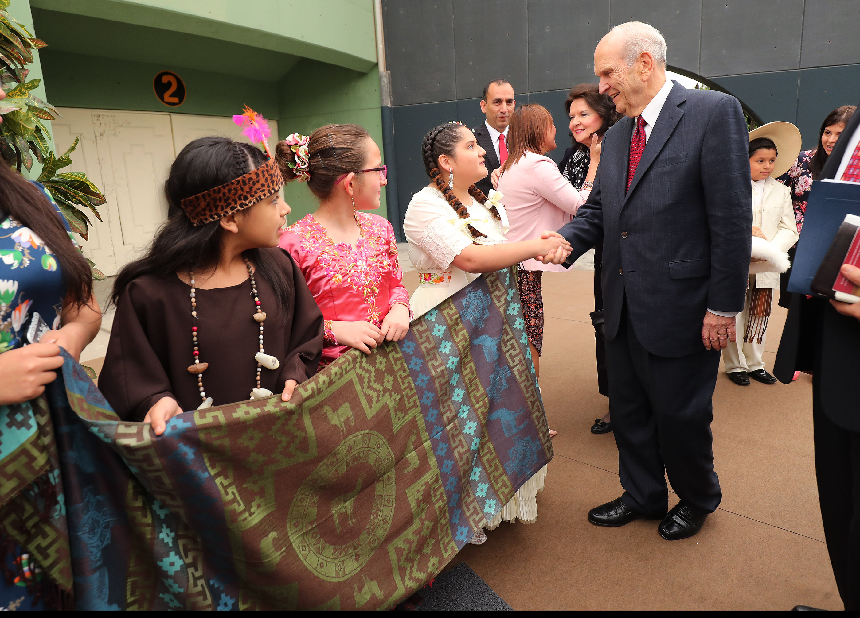President Russell M. Nelson of The Church of Jesus Christ of Latter-day Saints is greeted prior to a devotional in Lima, Peru on Oct. 20, 2018.