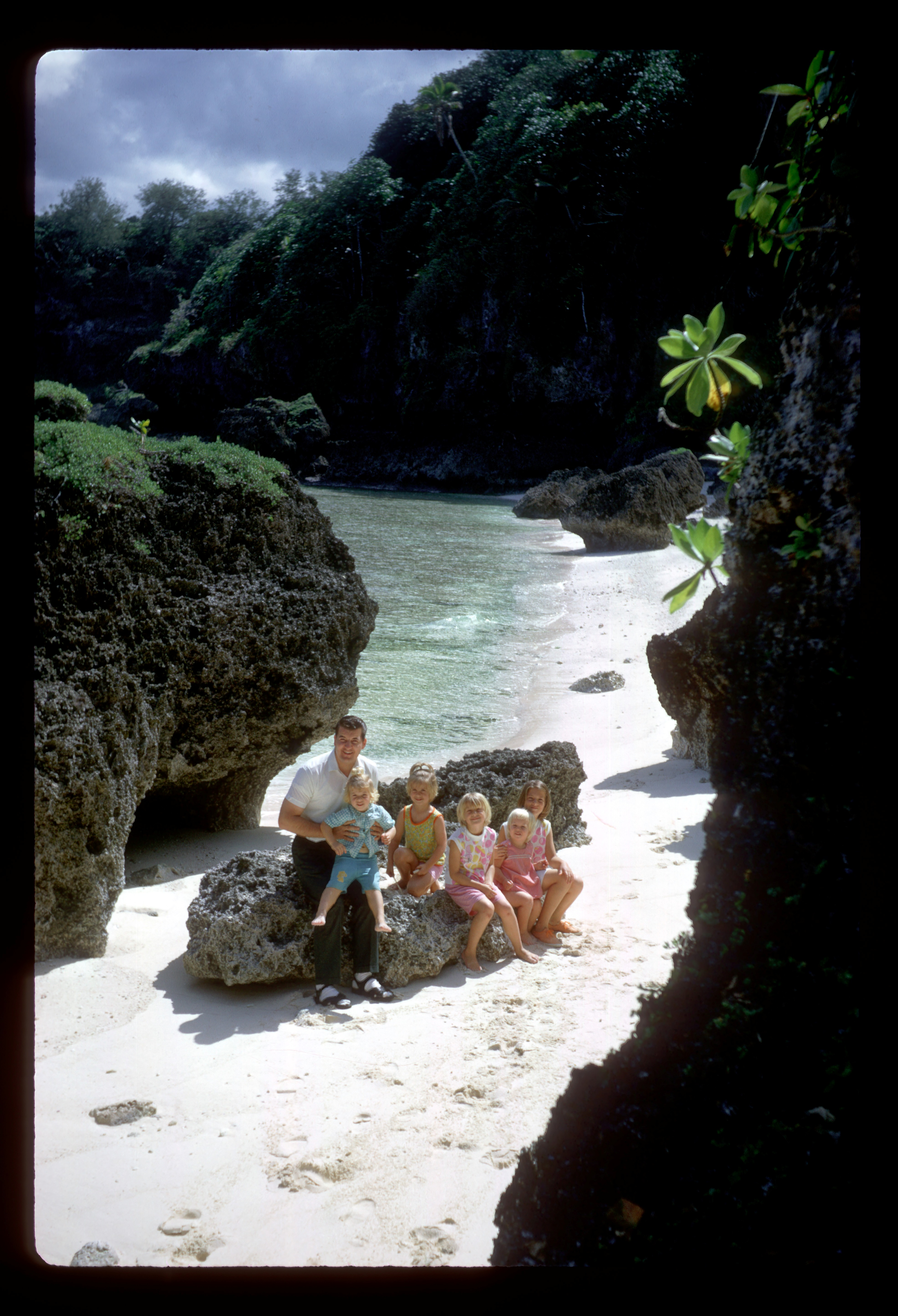 Elder John Groberg poses with some of his children on the beach in Hufanga Lupe, Tonga in August 1968.