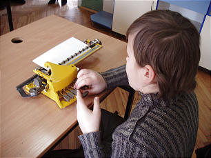 A student demonstrates the use of a Braille writer at the Dimitar Vlakov School for the Blind in Skopje, Macedonia.
