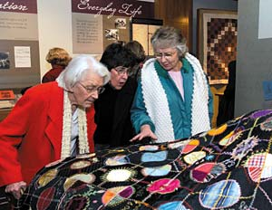 "Guests view new BYU exhibit, ""To Tell the Tale: Preserving the Lives of Mormon Women,"" after ribbon cutting Jan. 21. The display includes artifacts collected from Latter-day Saint women over the past 170 years."