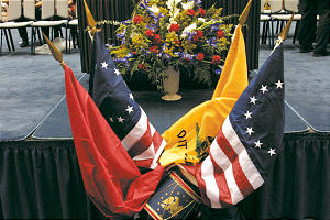 Flags, flowers are placed in memorial.