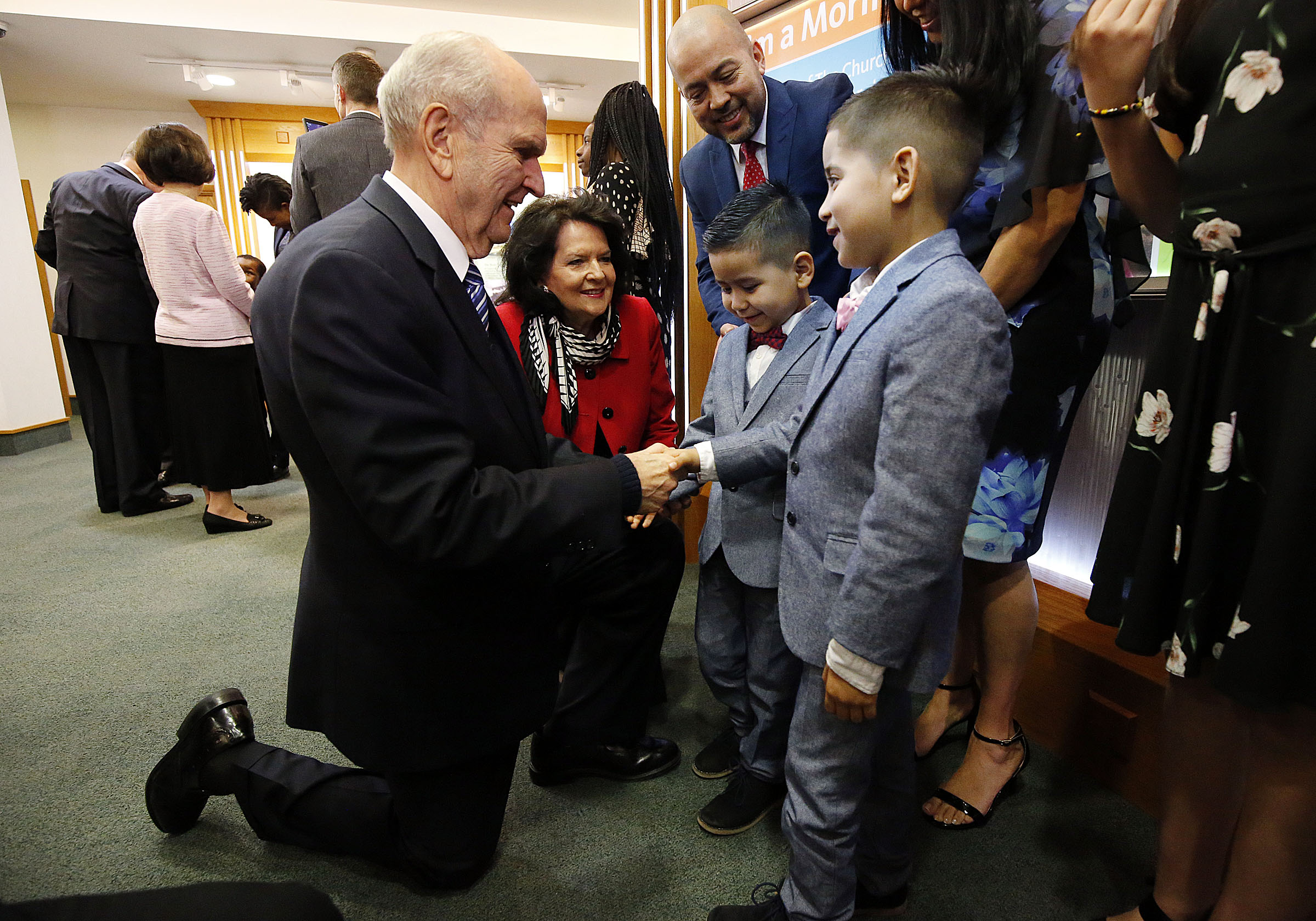 President Russell M. Nelson and Sister Wendy Nelson greet the Vargas family at the Hyde Park Visitors Center in London on Thursday, April 12, 2018. The boys are Juan David Vargas Saavedra, right, and Joseph Daniel Vargas Saavedra.
