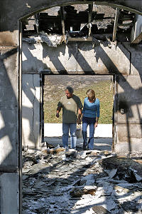 Glenn and Shari Kunz of the Fallbrook 1st Ward survey the damage fire did to their home. They said support from Church members kept their loss from being as devastating as it could have been. Now homeless, they were offered many places to stay.