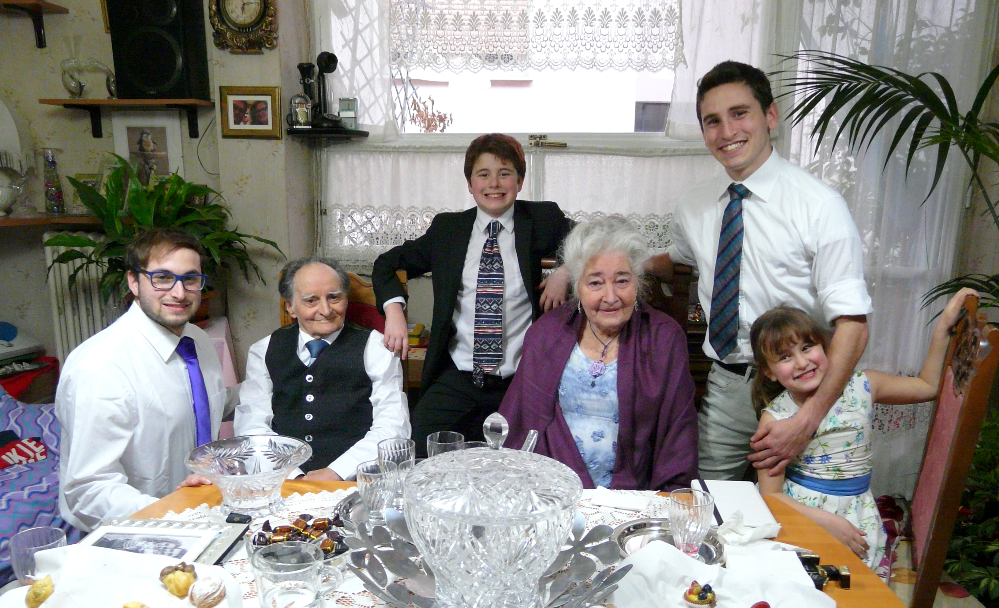 Agostino and Pierina Vardeu are surrounded by some of their grandchildren. The two older boys pictured have served full-time missions.