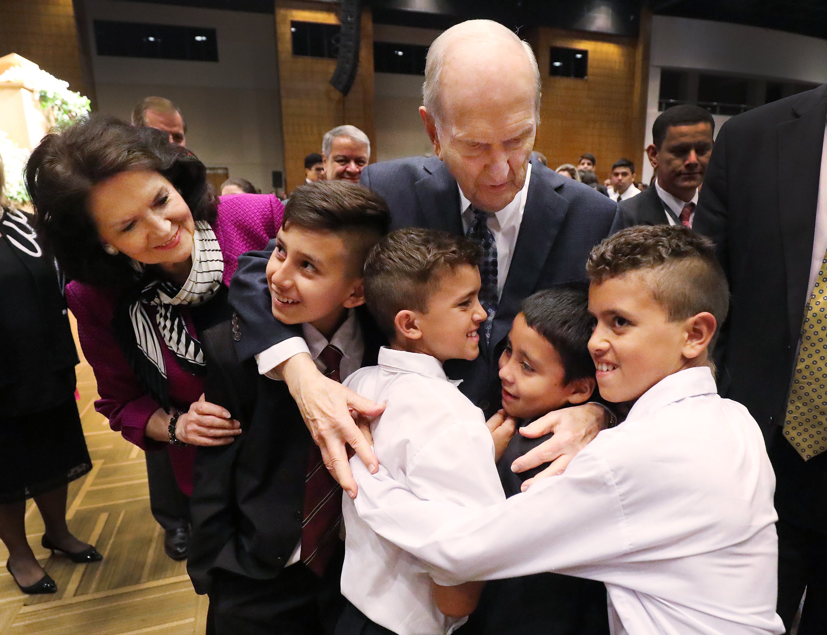 President Russell M. Nelson and his wife, Sister Wendy Nelson, hug children after a devotional in Asuncion, Paraguay, on Monday, Oct. 22, 2018.