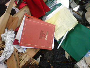 Latter-day Saint hymnbooks can be seen in the remains of the Joplin Missouri Stake Center, which was destroyed by a tornado May 22.