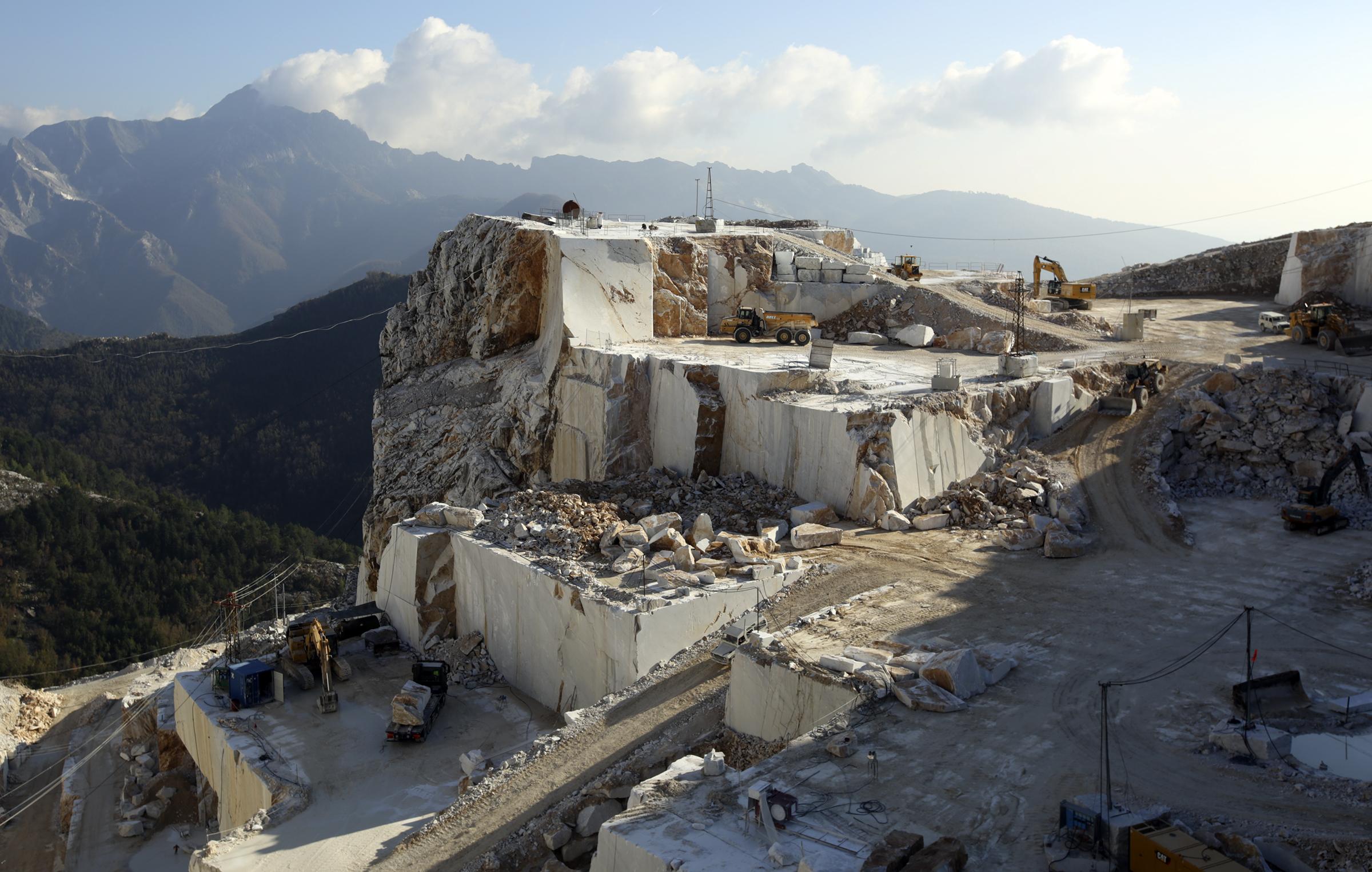 Trucks move marble blocks at a marble quarry in Carrara, Italy, on Thursday, Nov. 15, 2018.