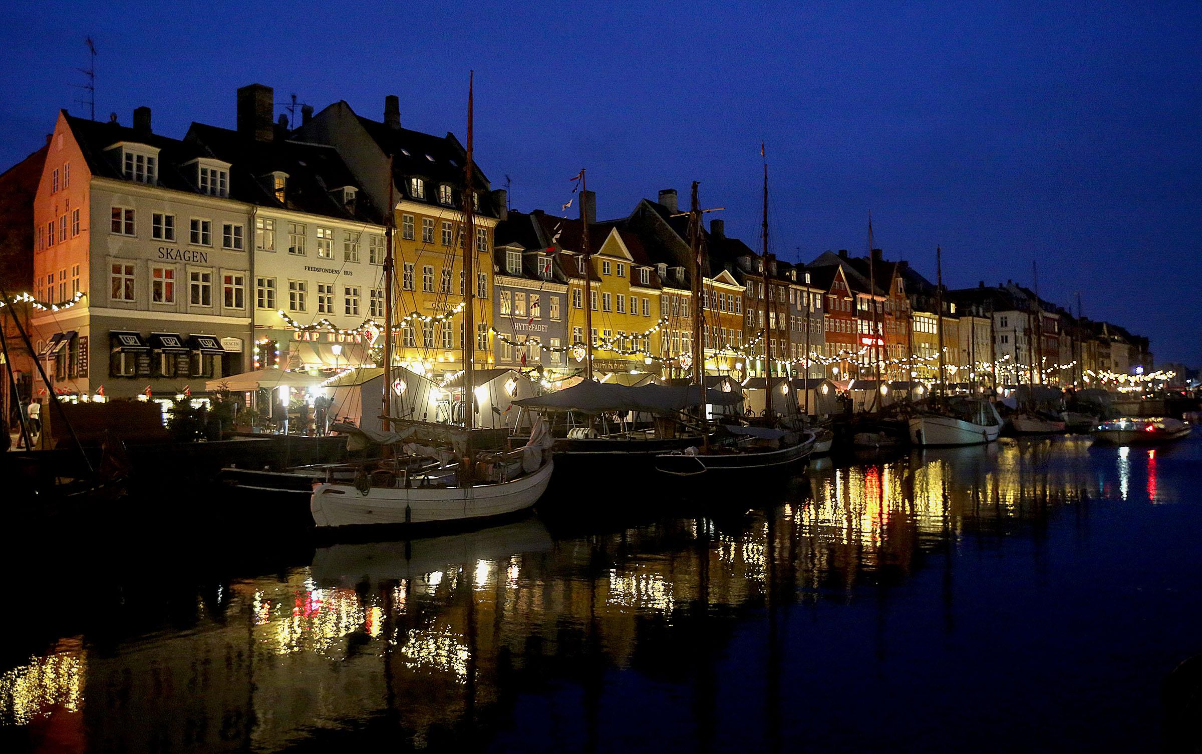 Christmas markets light up Nyhavn in Copenhagen, Denmark, on Tuesday, Nov. 13, 2018.