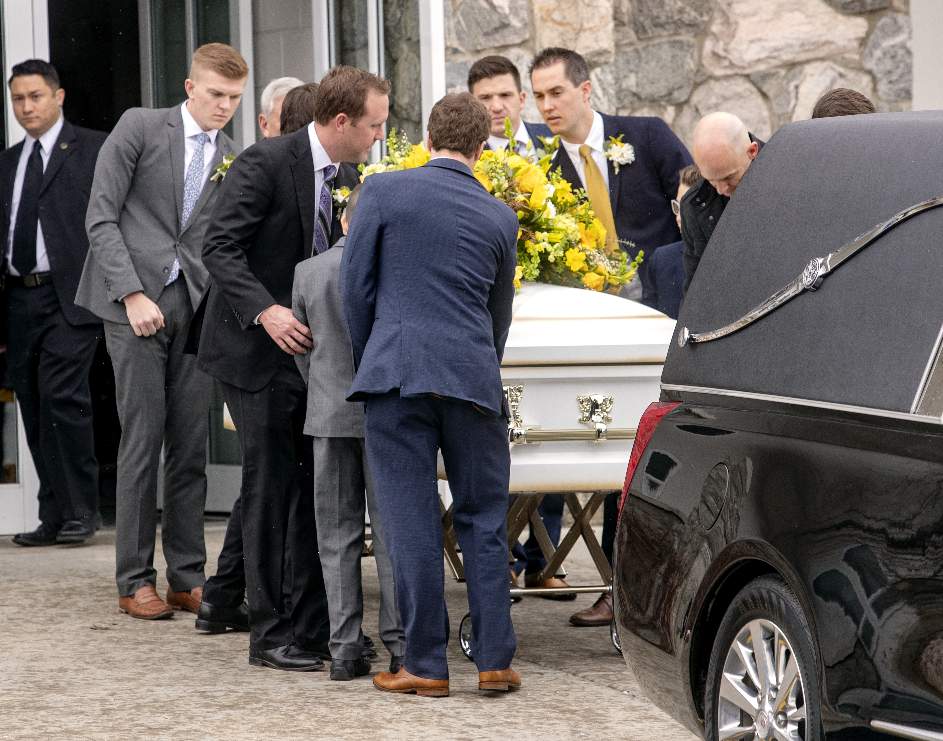 The casket of Wendy Nelson Maxfield is lifted and placed into the hearse after funeral services in the the Cottonwood Heights Utah Brighton Stake Center on Saturday, Jan. 19, 2019.