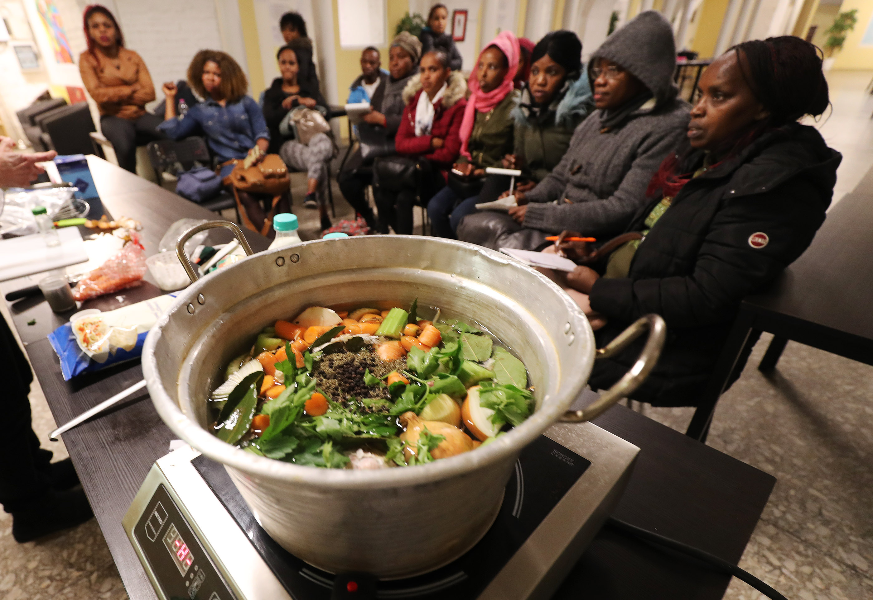 Refugees attend cooking class taught by Latter-day Saint Charities missionaries at St. Paul's Within the Walls Episcopal Church in Rome, Italy on Thursday, March 7, 2019. The Church of Jesus Christ of Latter-day Saints partners with the Catholic church to help refugees.