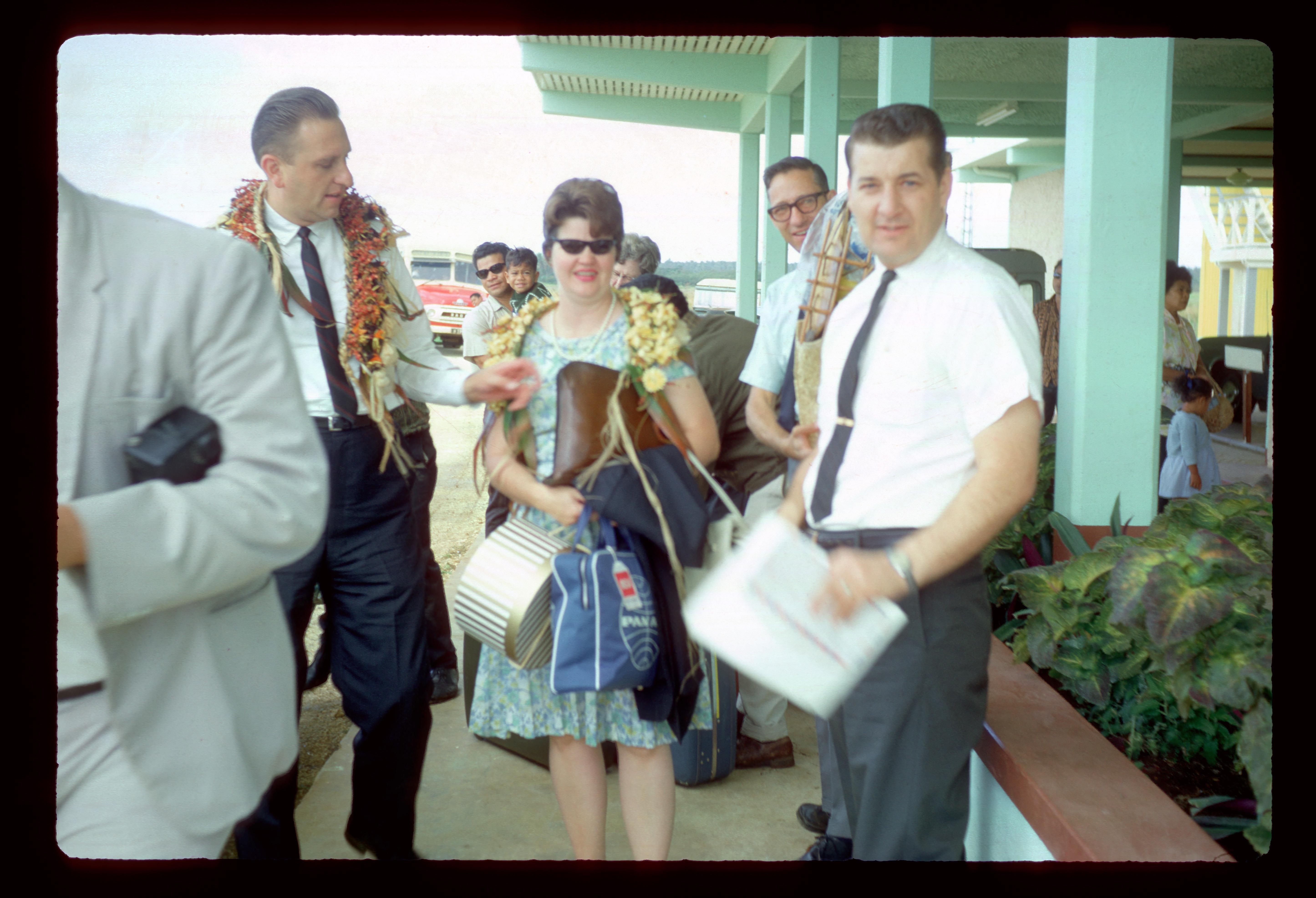 Elder Thomas S. Monson, left, joins Tonga Mission President John Groberg, right, at the airport in Tonga during a stake visit in September 1968.