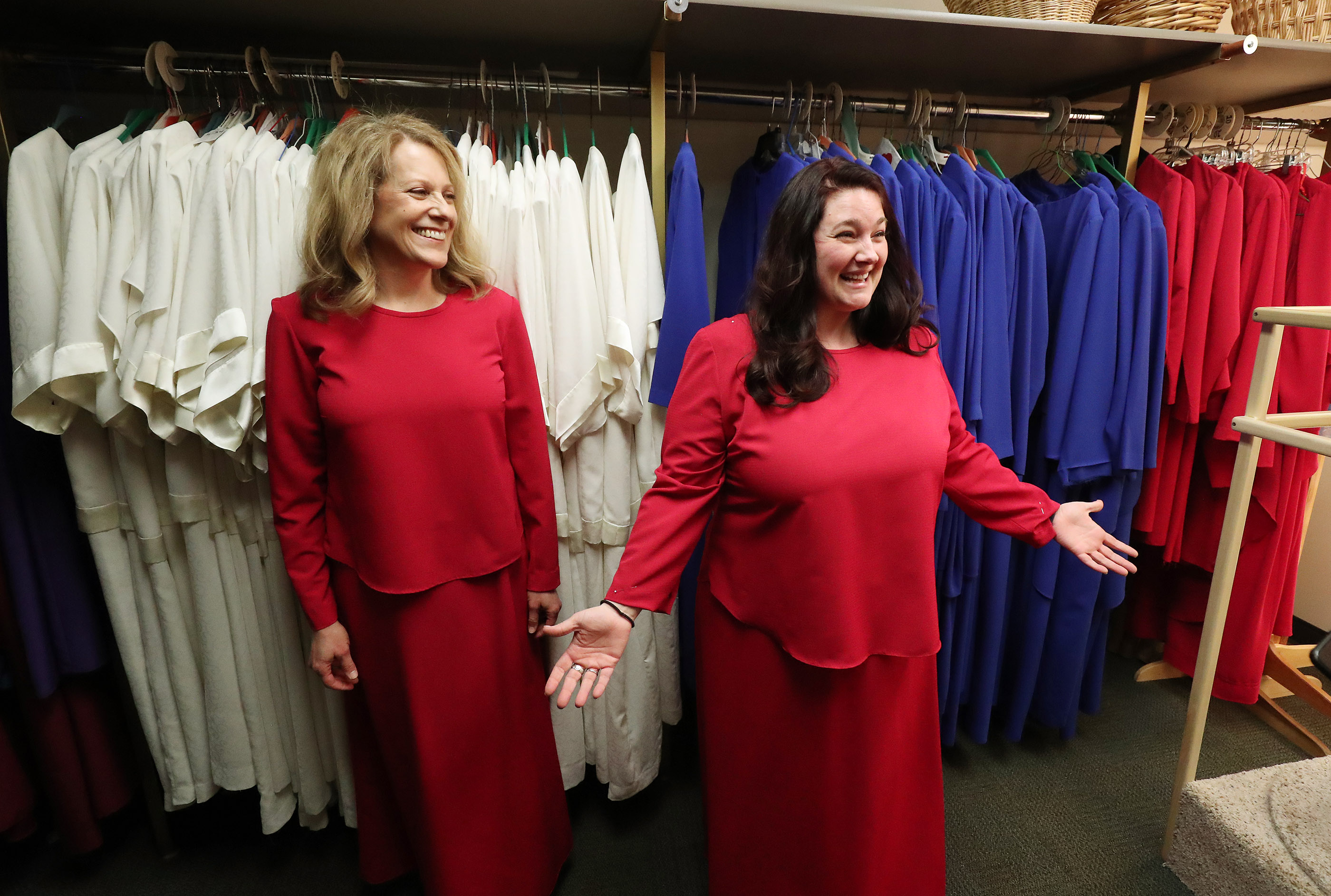 Debbie Matheson, left, and McKenna Reynolds try on dresses in preparation to sing with The Tabernacle Choir at Temple Square during a rehearsal in Salt Lake City on Thursday, April 11, 2019. Four people were selected through social media to sing with the choir.