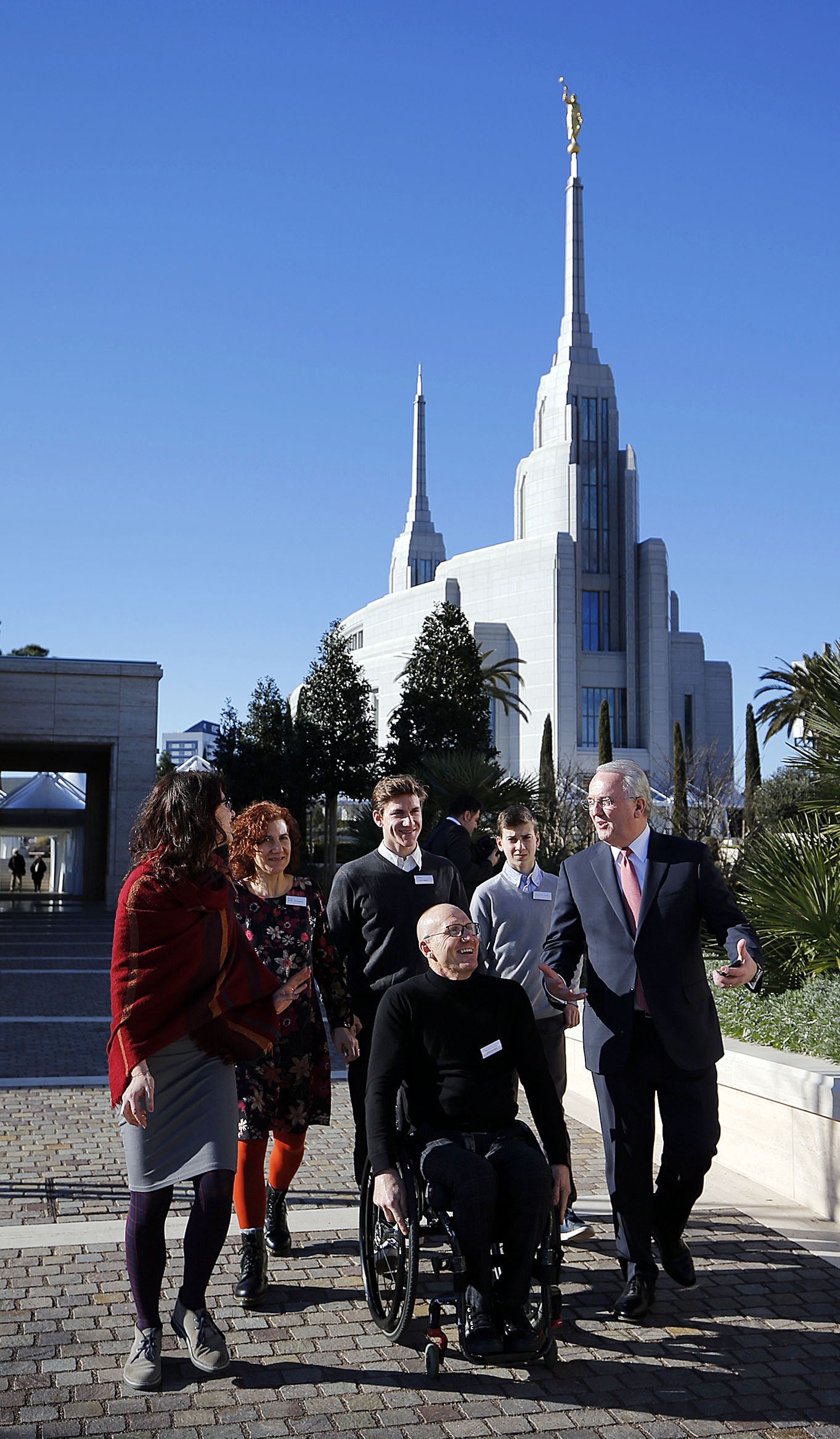 Elder Jack N. Gerard, right, of The Church of Jesus Christ of Latter-day Saints, leads Paralympian Paolo Cecchetto and his family on a tour of the Rome Italy Temple and grounds on Tuesday, Jan. 15, 2019.