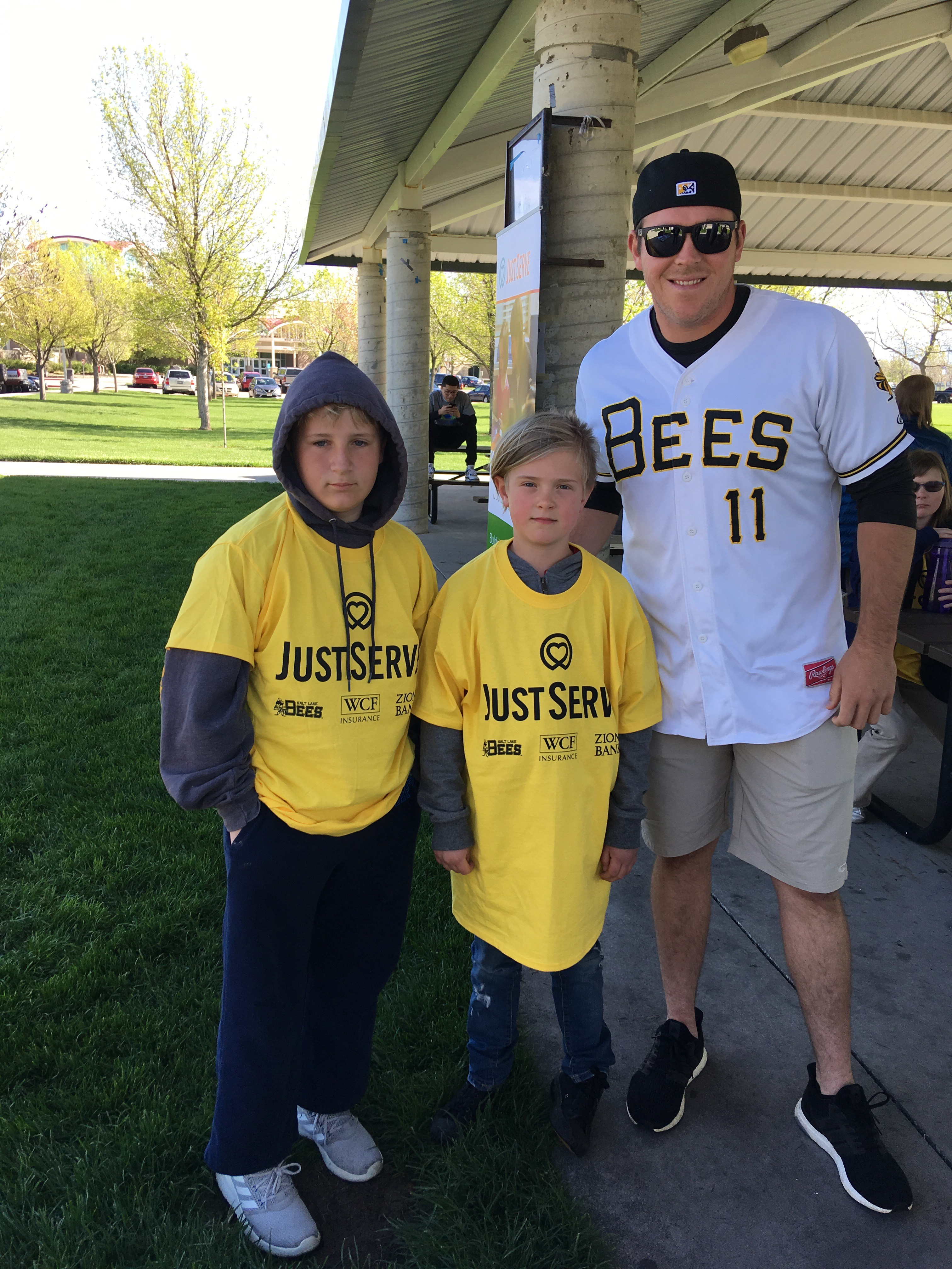 Two young JustServe volunteers pose with Salt Lake Bees pitcher, Greg Mahle, as part of the Salt Lake Bees/JustServe day of service on April 27.