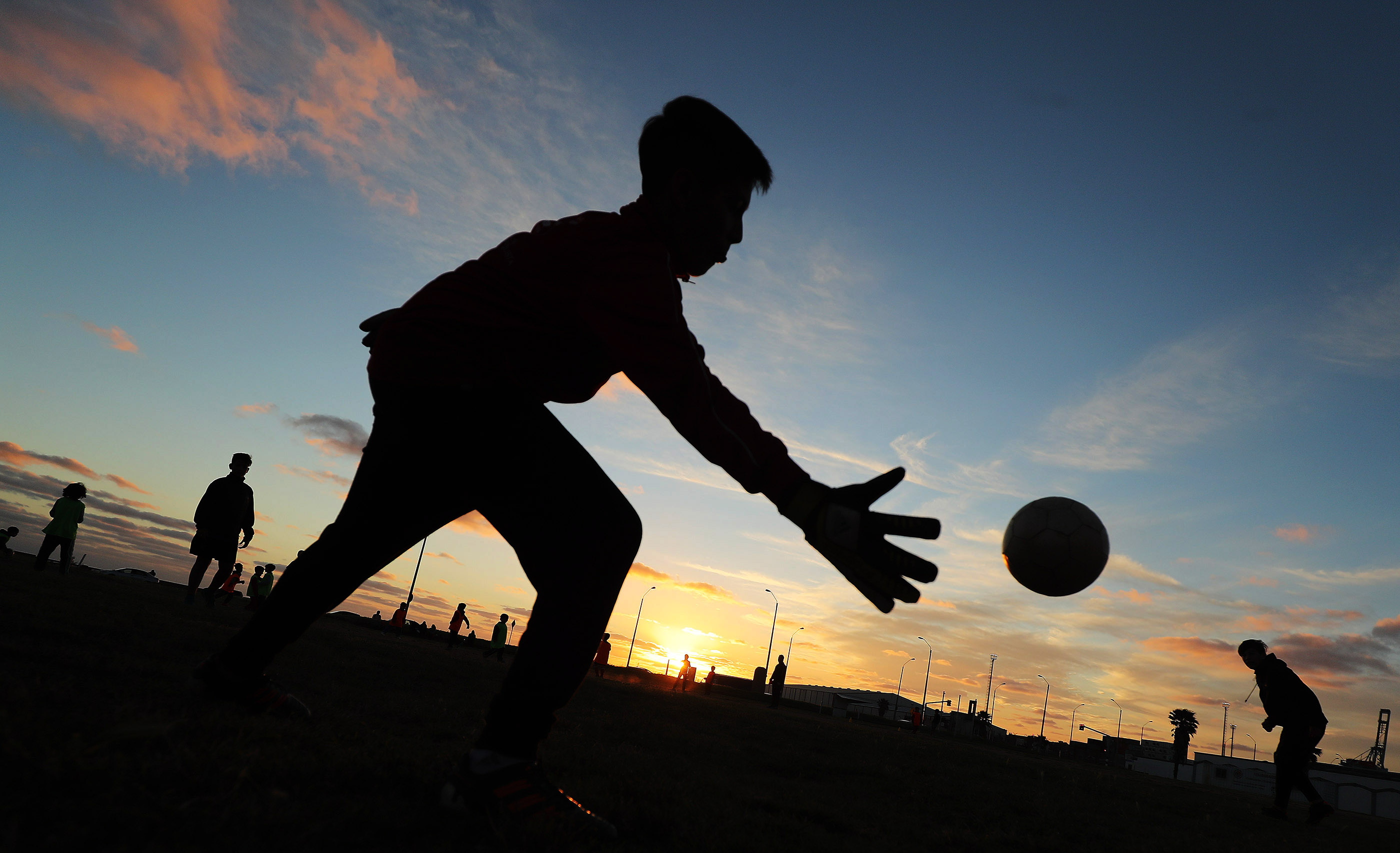 Children play soccer as the sun sets in Montevideo, Uruguay, on Oct. 23, 2018.