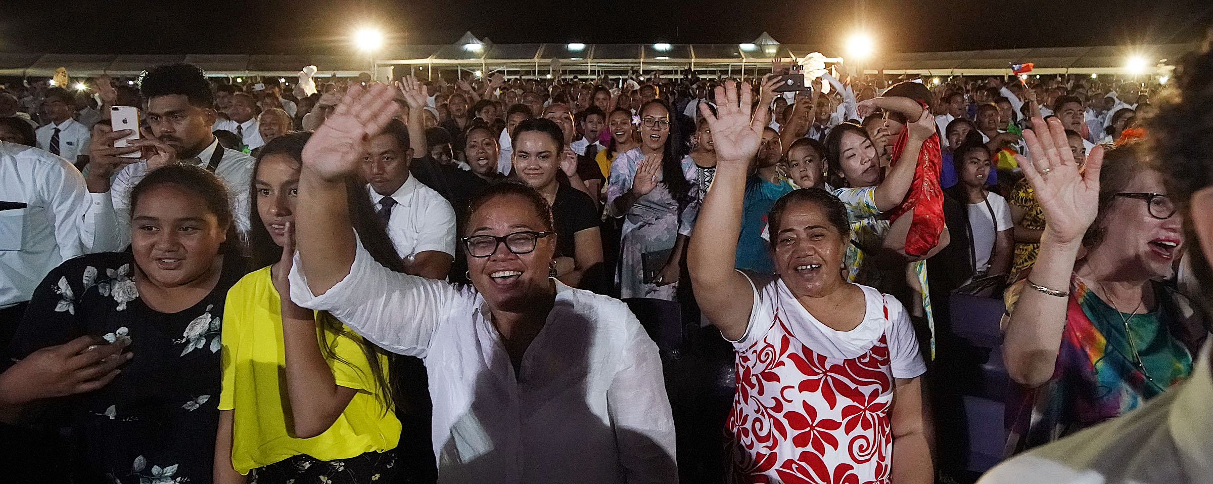 Many of those in attendance wave and sing as President Russell M. Nelson of The Church of Jesus Christ of Latter-day Saints and his wife, Sister Wendy Nelson, leave following a devotional in Apia, Samoa, on Saturday, May 18, 2019.