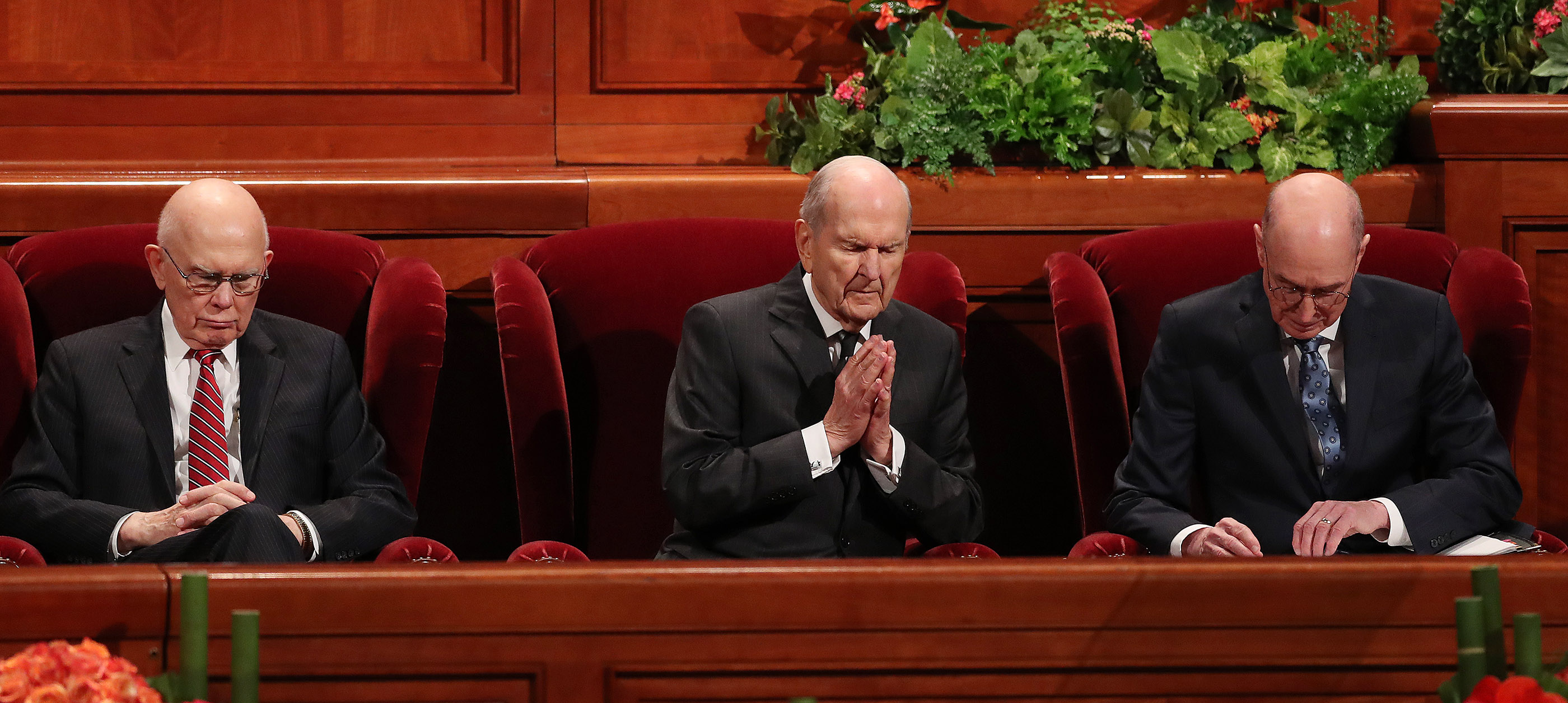 President Russell M. Nelson of The Church of Jesus Christ of Latter-day Saints, center, and his counselors, President Dallin H. Oaks, first counselor in the First Presidency, left, and President Henry B. Eyring, second counselor in the First Presidency, right, listen to the prayer during the 188th Semiannual General Conference of The Church of Jesus Christ of Latter-day Saints in Salt Lake City on Saturday, Oct. 6, 2018.