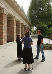 Sister missionaries assigned to Temple Square help tourists understand the Church's rich history and answer their questions.