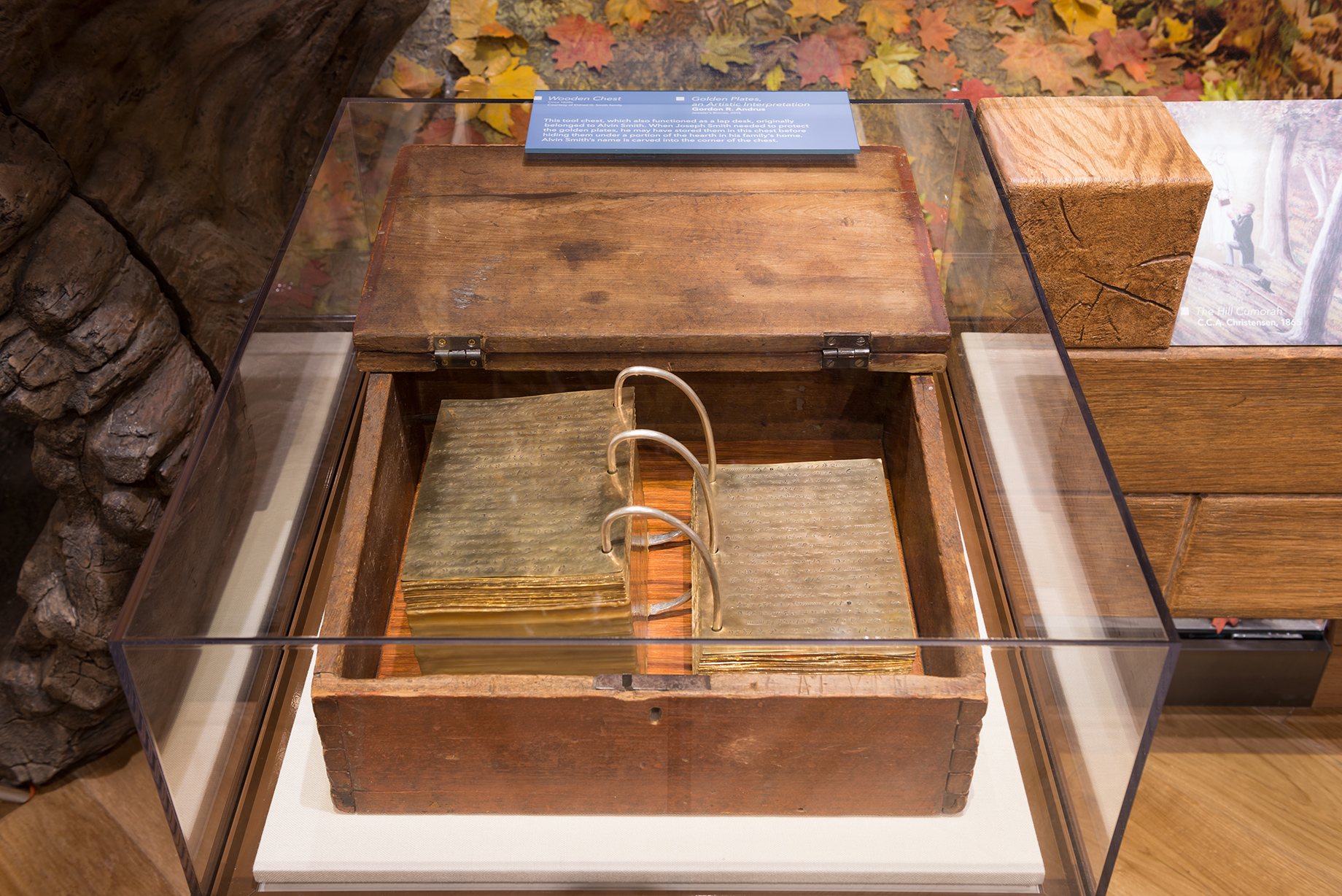 """Replica of Book of Mormon plates that silversmith Gordon Andrus made as they are displayed in """"The Heavens Are Opened"""" exhibit at the Museum of Church History and Art."""