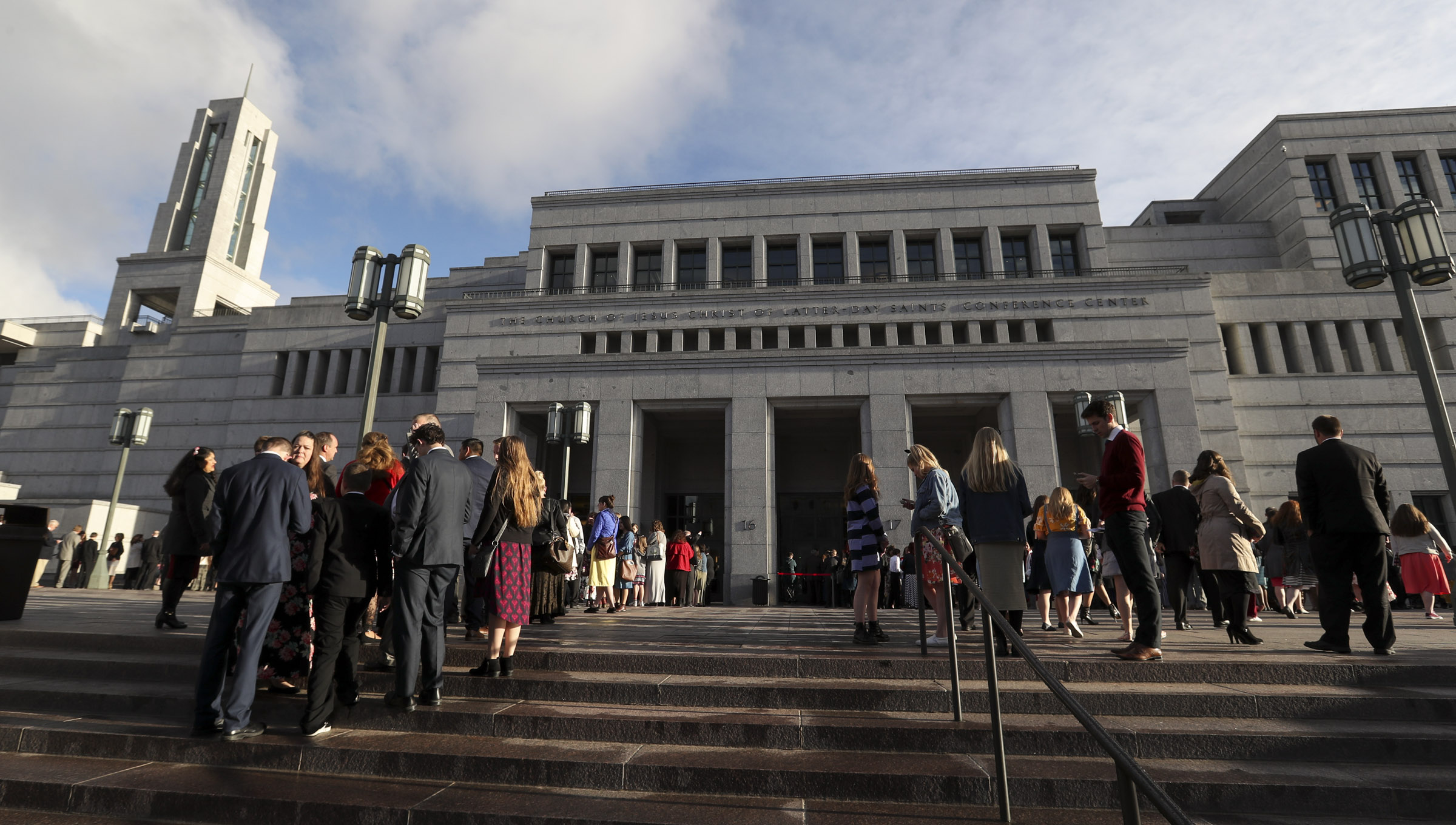 Latter-day Saints wait in line at the Conference Center before the Saturday morning session of the 189th Annual General Conference of The Church of Jesus Christ of Latter-day Saints in Salt Lake City on Saturday, April 6, 2019.