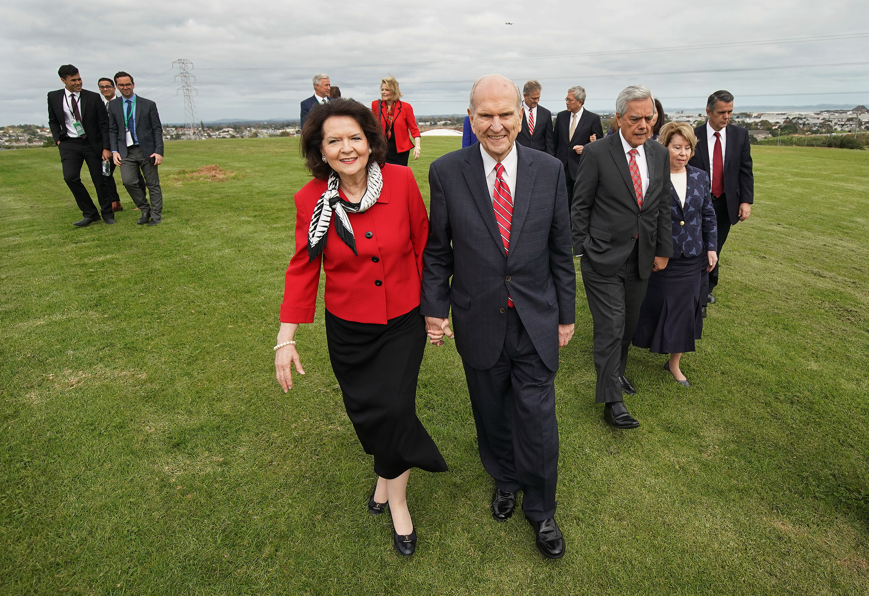 President Russell M. Nelson of The Church of Jesus Christ of Latter-day Saints and his wife, Sister Wendy Nelson, walk on ground for the new temple in Auckland, New Zealand, on May 21, 2019.