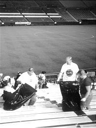 Members of the Hingham Massachusetts Stake collect garbage following a professional soccer game.