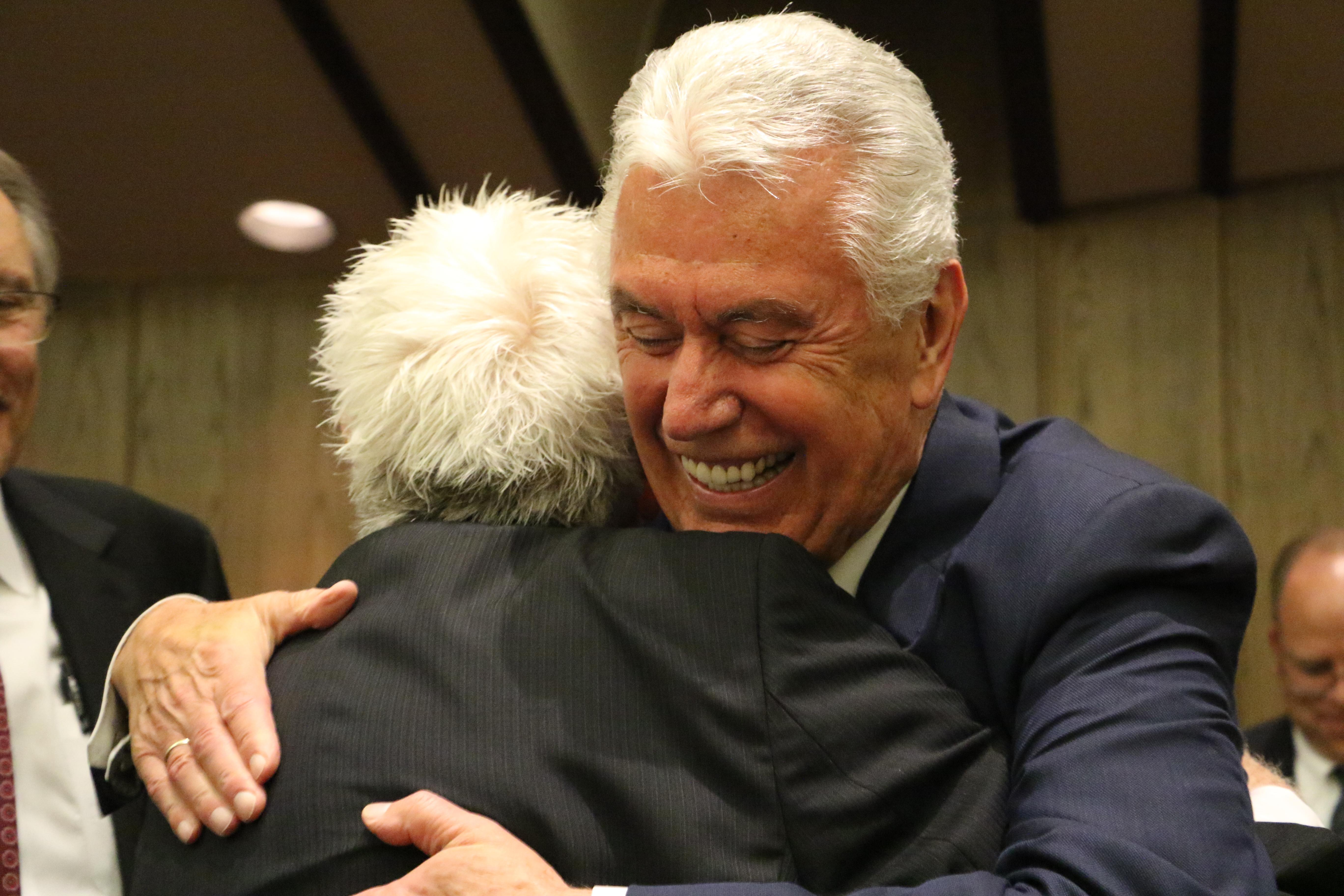 Elder Dieter F. Uchtdorf of the Quorum of the Twelve Apostles hugs a member of the German Speaking Ward after the final sacrament meeting on July 14, 2019, in Salt Lake City.