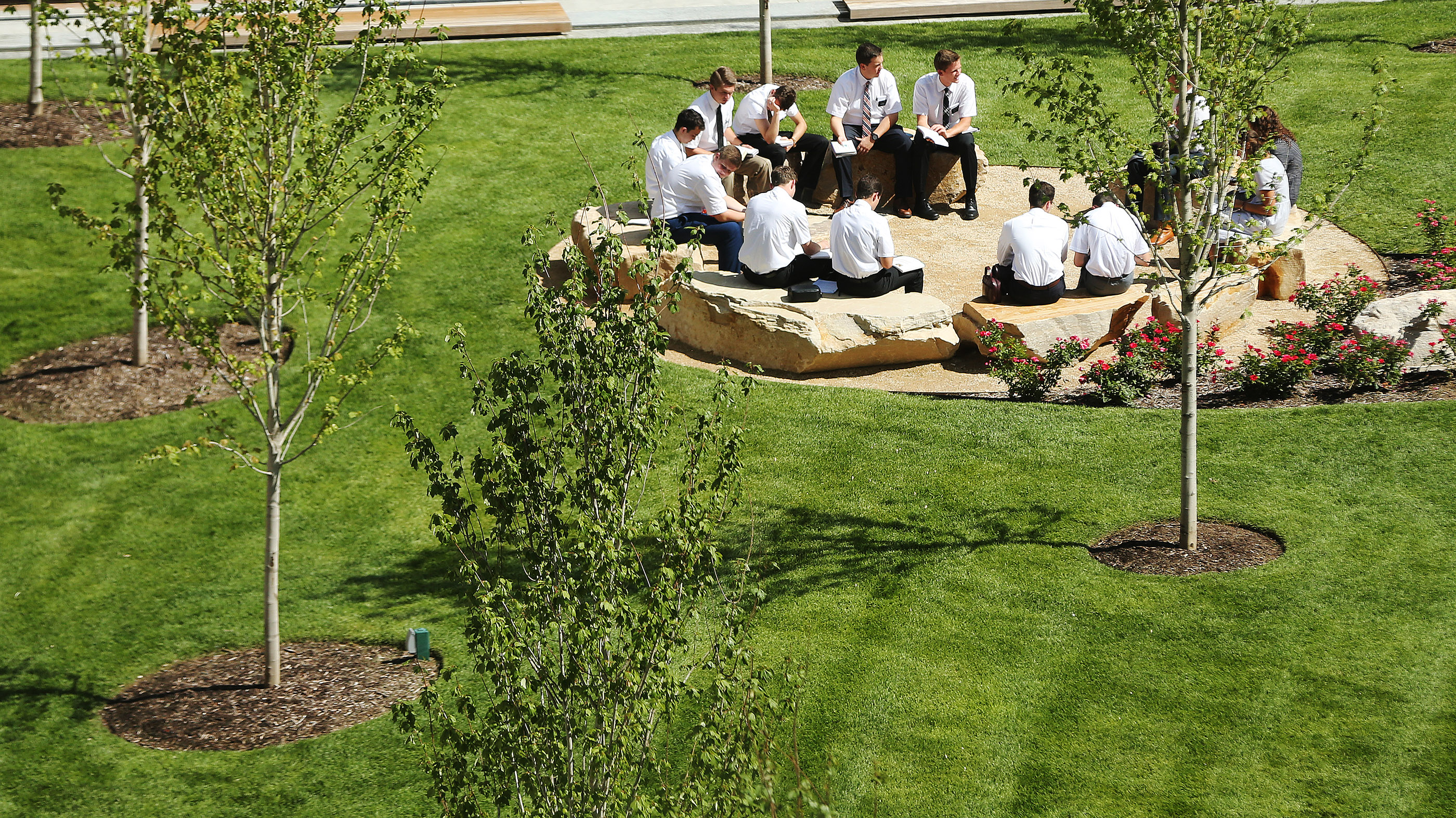 Missionaries study outside in an open-space setting at the Provo Missionary Training Center in Provo on Wednesday, July 26, 2017.