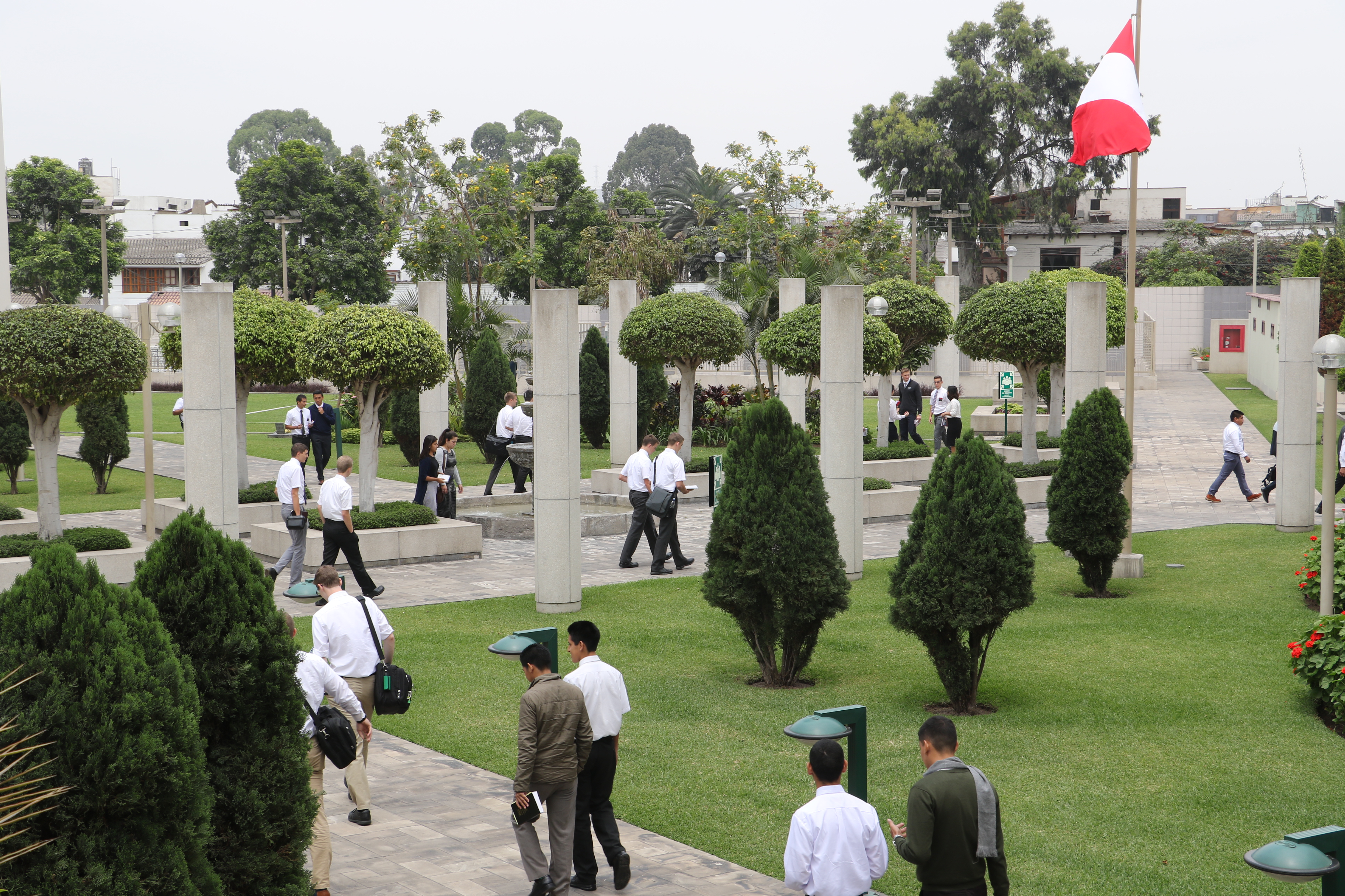 Missionaries walk across the grounds of Peru Missionary Training Center on Oct. 19, 2018.