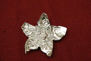 In post-war Germany, Sister Harriet Reich Uchtdorf's mother made a Christmas ornament out of tin foil; in the center was a piece of caramelized sugar.