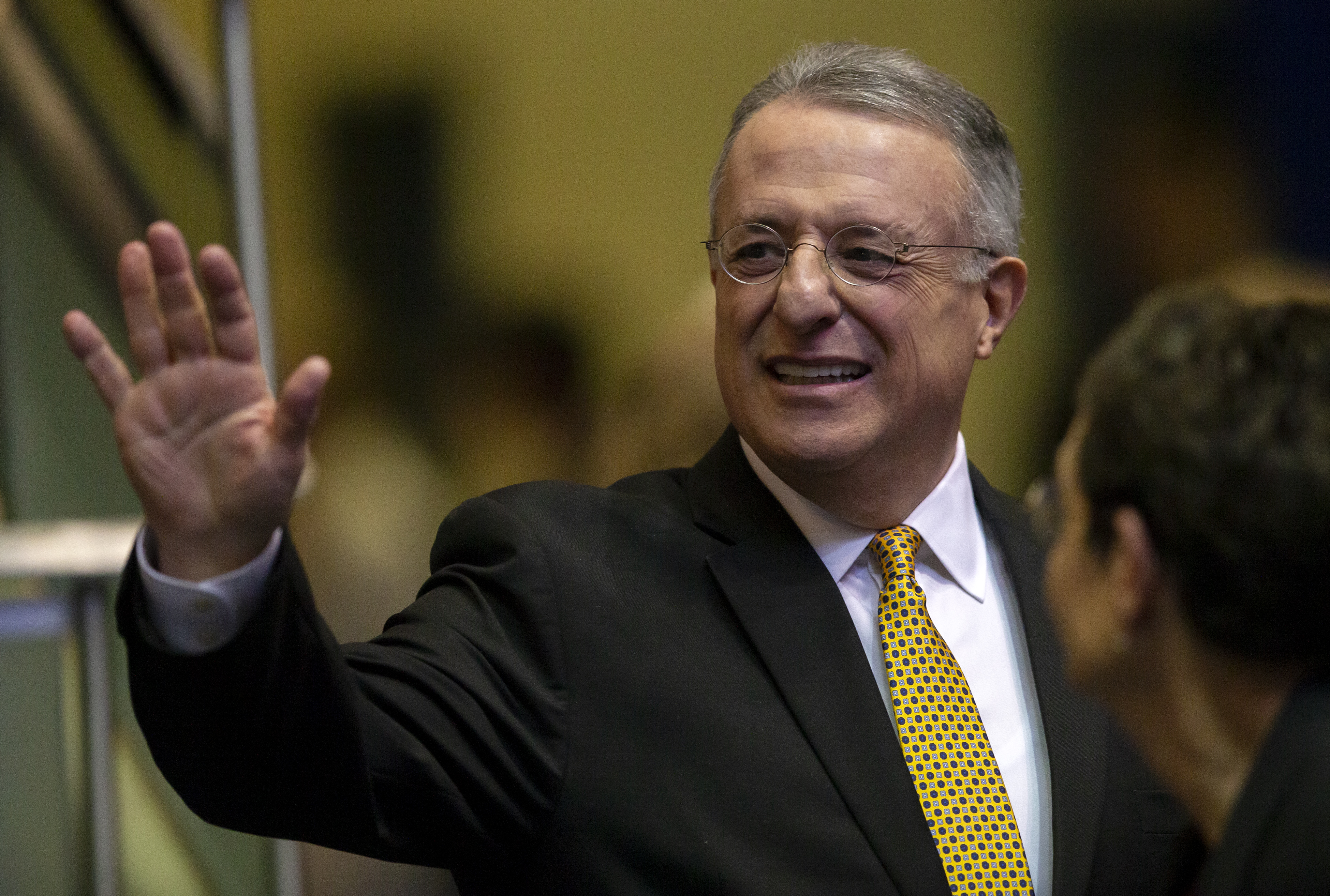 Elder Ulisses Soares of the Quorum of the Twelve Apostles of The Church of Jesus Christ of Latter-day Saints waves as he exits after speaking at a devotional at BYU in Provo on Tuesday, Feb. 5, 2019.