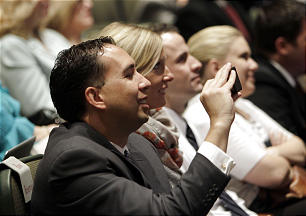 Michael Jensen records the event as the Mormon Tabernacle Choir announces the launch of its new YouTube channel in Salt Lake City, Tuesday, Oct. 30, 2012.