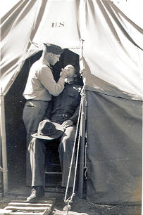 LaGrand Nielsen performs a dental procedure on a fellow soldier in the field. Brother Nielsen served almost three decades in the U.S. Army.