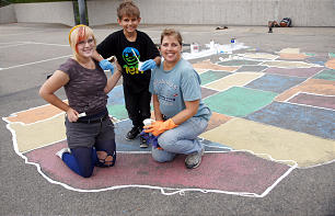 Members of the Hales family pose on a map of the United States. Stephanie Hales enlisted the help of her children to restore the fading map at Marblehead Elementary in San Clemente, Calif.