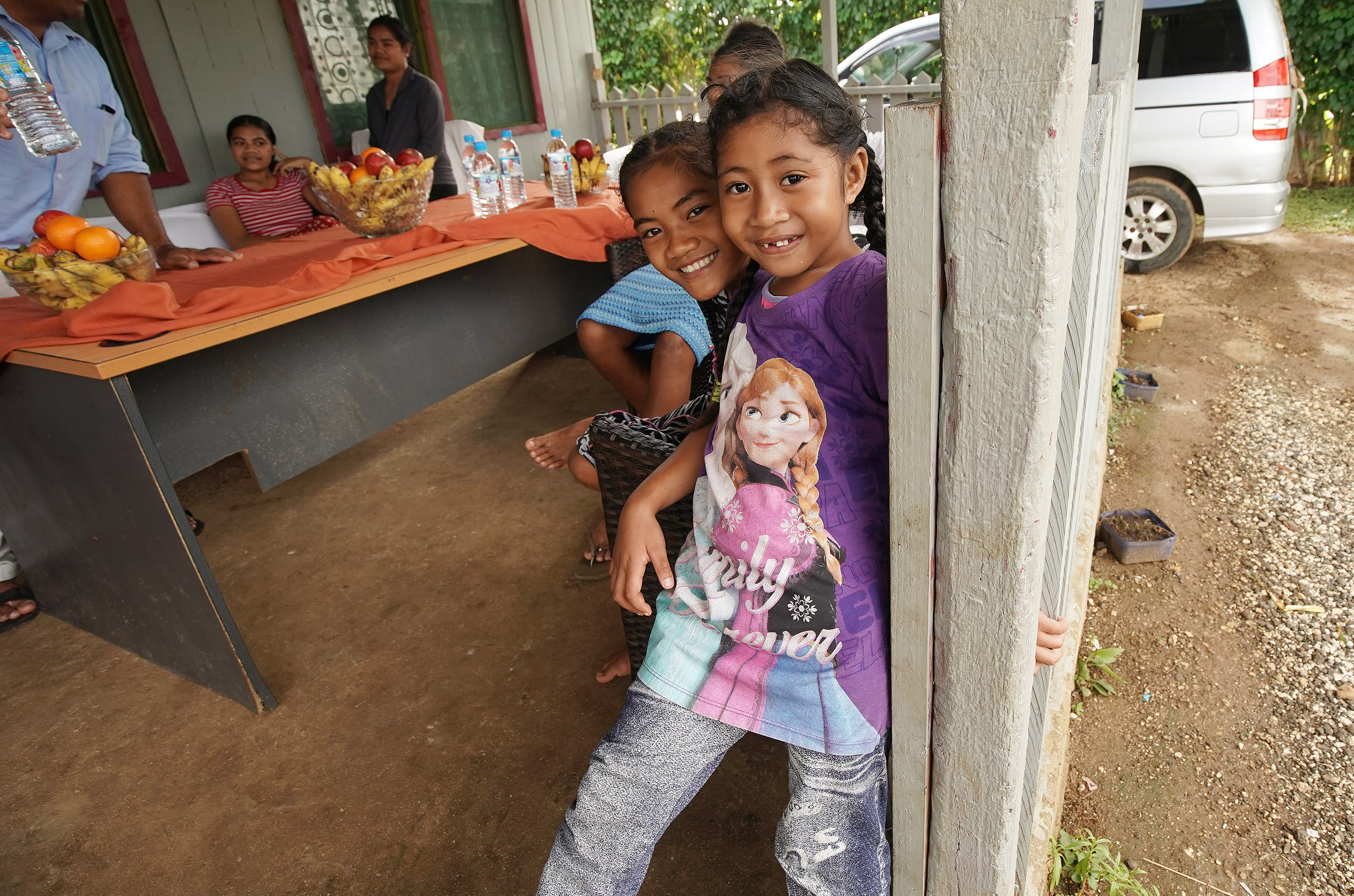 Cousins Katherine Latu and Falakika Latu play at home in Tonga on May 23, 2019. Their dad and uncle Tohiminiti Latu is bishop of his ward has 10 children and one grandchild.