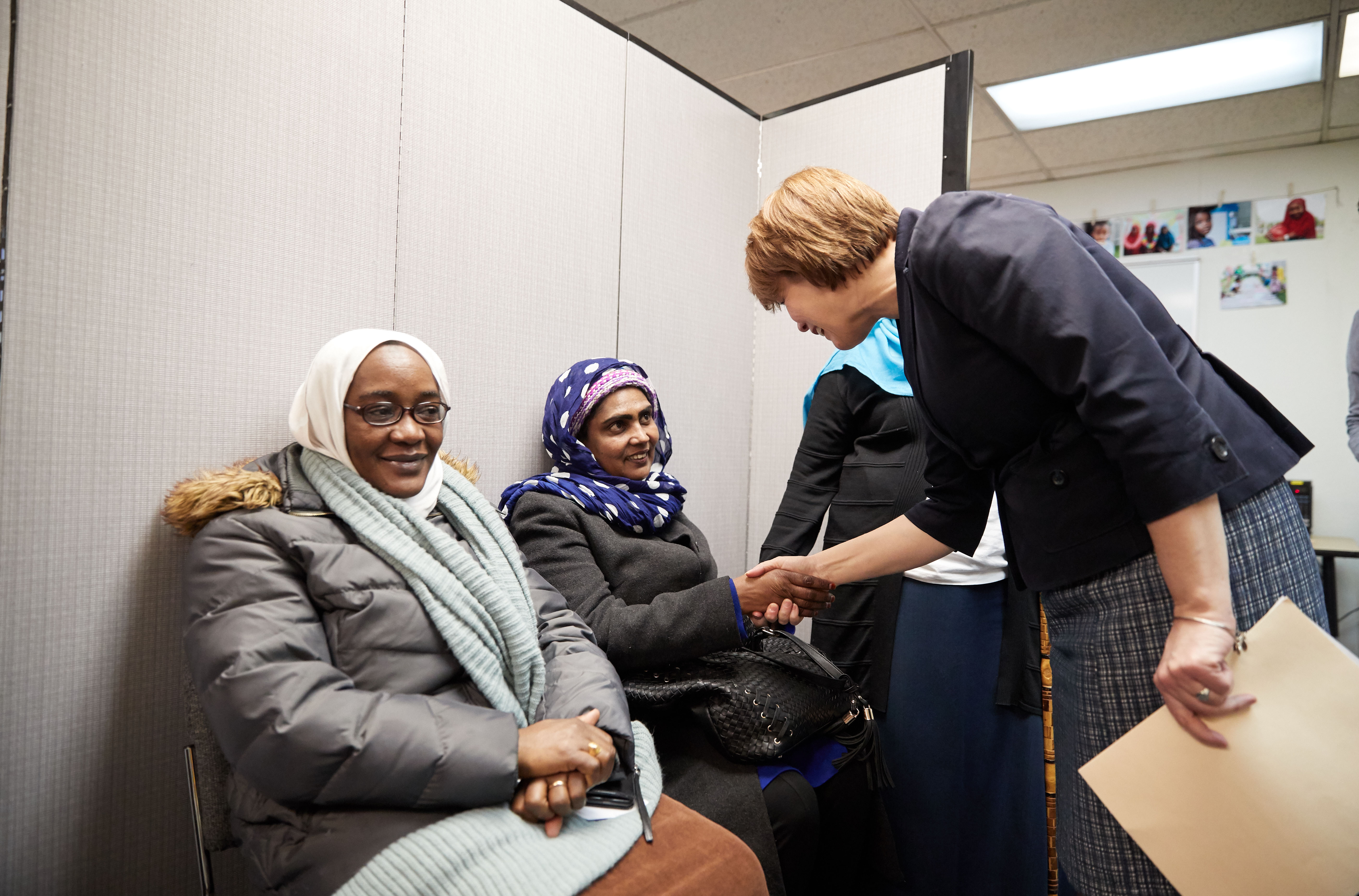 Sister Sharon Eubank, first counselor in the Relief Society general presidency and director of LDS Charities greets clients at the Utah Refugee Connection February 7, 2019.