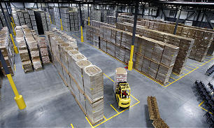 A worker moves goods at the new 570,000 square foot Utah Bishops' Central Storehouse in Salt Lake City, Thursday, Jan. 26, 2012.