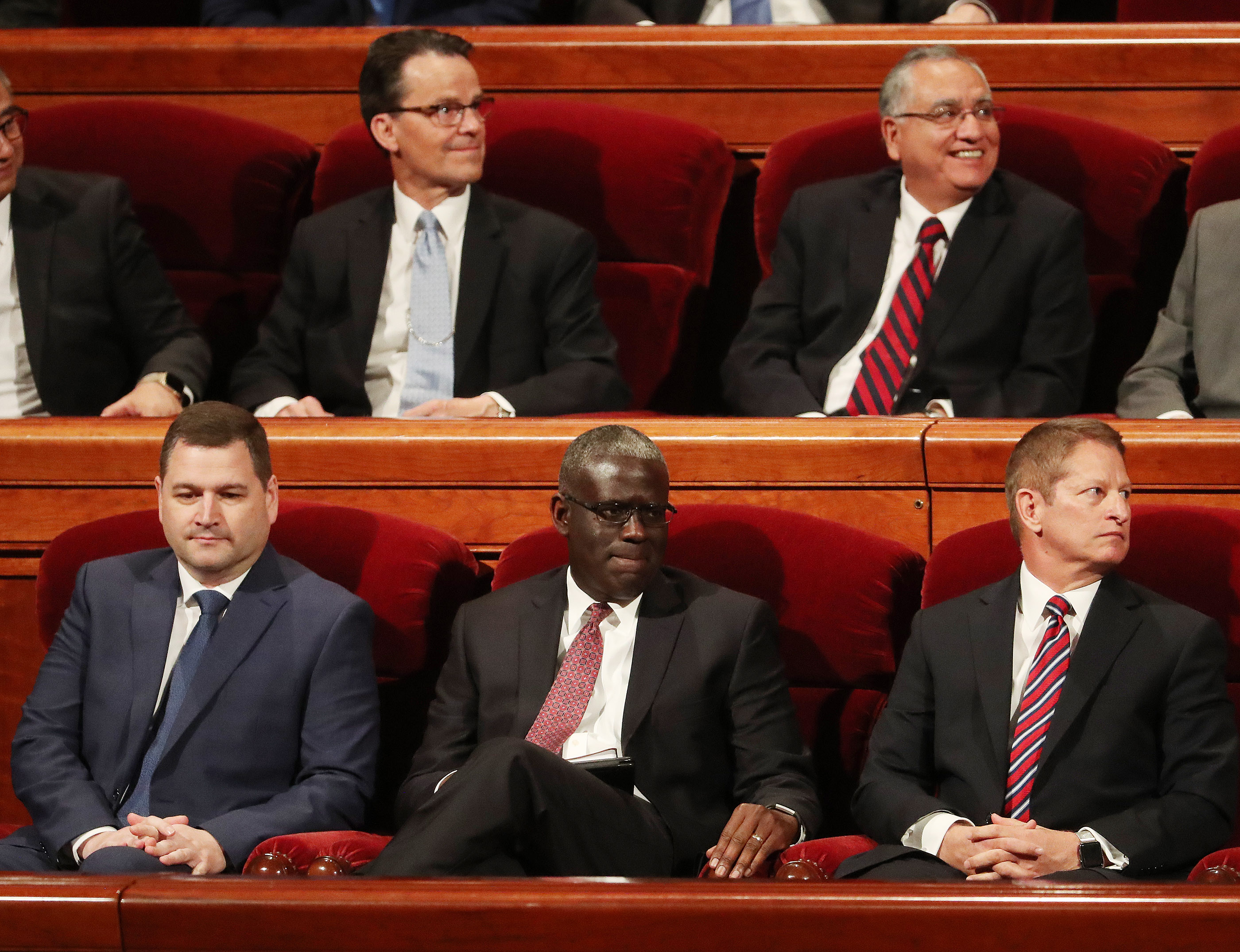 Elder Peter M. Johnson, new General Authority Seventy of The Church of Jesus Christ of Latter-day Saints, center, takes the stand during the Saturday afternoon session of the 189th Annual General Conference of The Church of Jesus Christ of Latter-day Saints in Salt Lake City in the Conference Center on Saturday, April 6, 2019.