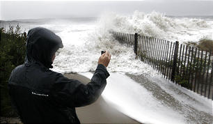 Longtime Cape May resident John Cooke gets a close look at rough surf pounding the beach Monday, Oct. 29, 2012, in Cape May, N.J., as high tide and Hurricane Sandy begin to arrive.