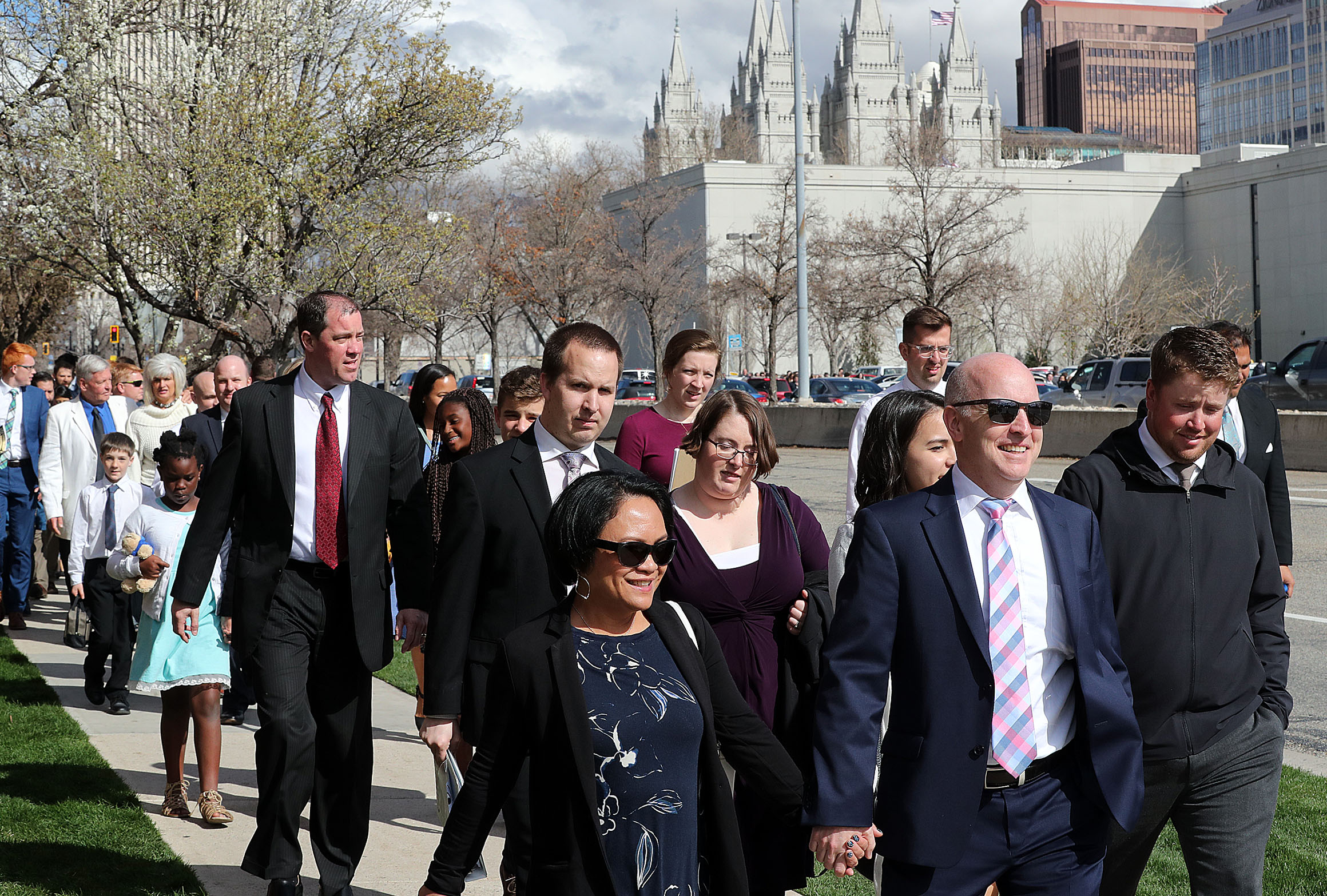 Conferencegoers walk away from the Conference Center following the afternoon session of general conference of The Church of Jesus Christ of Latter-day Saints in Salt Lake City on Saturday, April 6, 2019.
