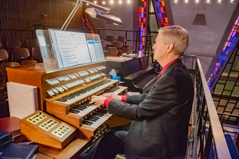 """Dr. Joseph Galema, Cadet Chapel guest organist fills the iconic USAFA chapel with the familiar, """"How Firm a Foundation."""""""