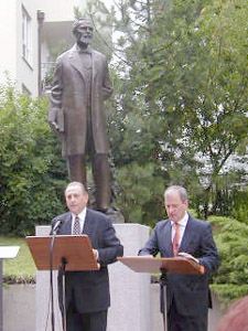 President Thomas S. Monson addresses audience with assistance of a translator after unveiling Karl G. Maeser statue during dedicatory services in Dresden, Germany, July 14. Photo by Rodney Taylor